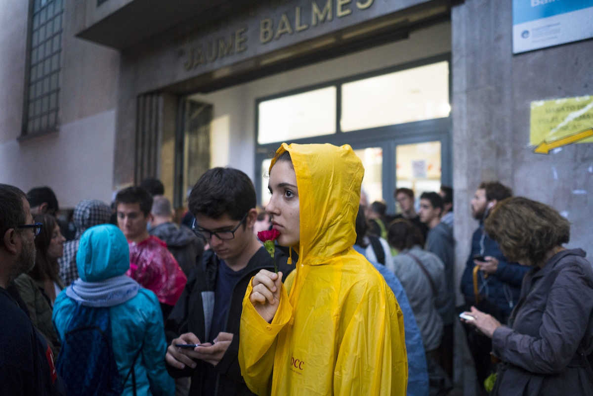 Ivett Dalmau, a student at the Jaume Balmes school waits with voters and students for election officials with ballot boxes to arrive, October 1st, 2017. The group stayed overnight at the school to protect the voting center from the threat of a shutdown by Spanish police forces.