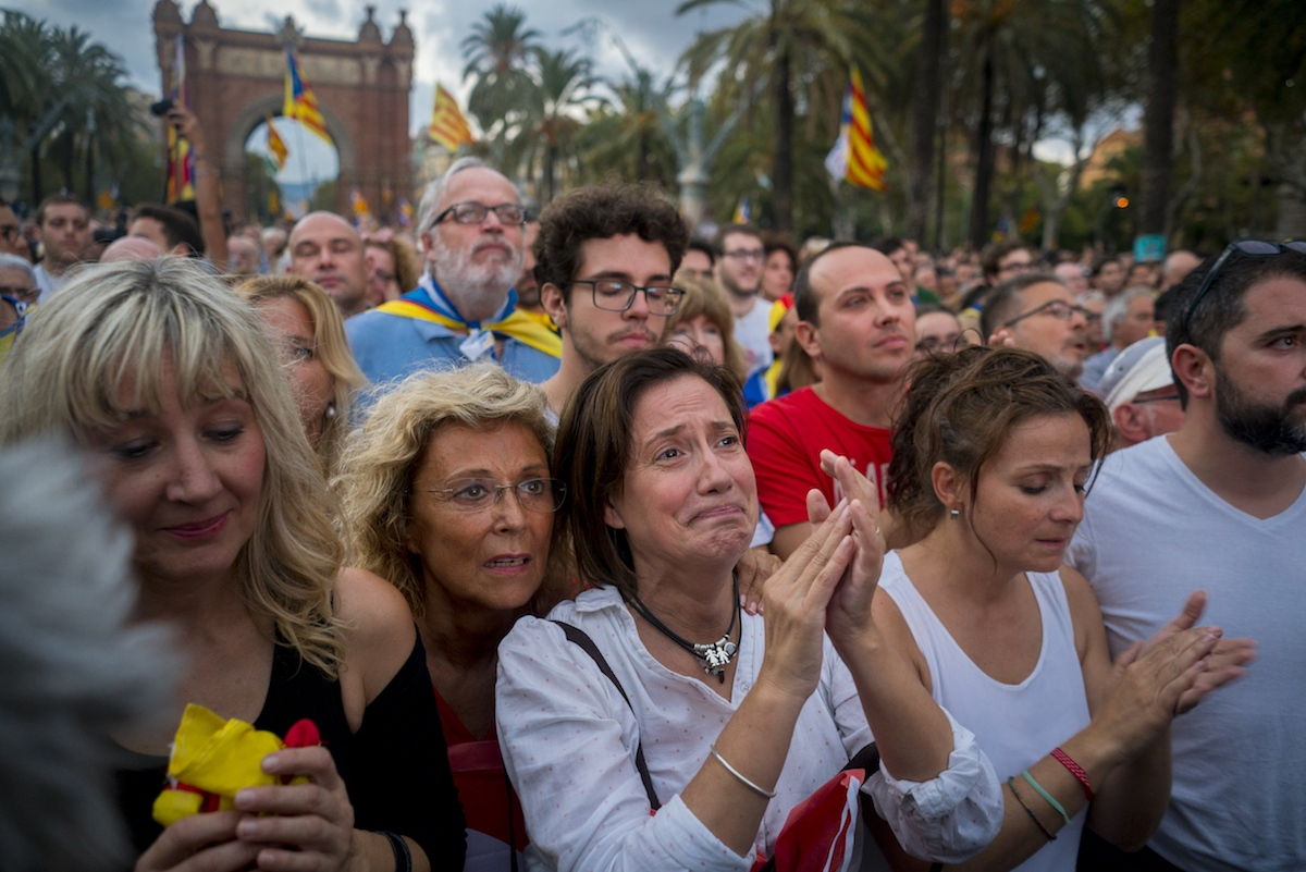 Muntsa Casas watches Catalan President Puigdemont's speech on a mega-screen in Barcelona on October 10th, 2017. After declaring independence Puigdemont suspended the declaration and invoked a pause for dialogue with Spain.