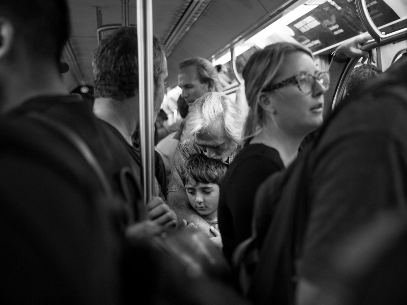 A father and son in the subway, New York, 2017.