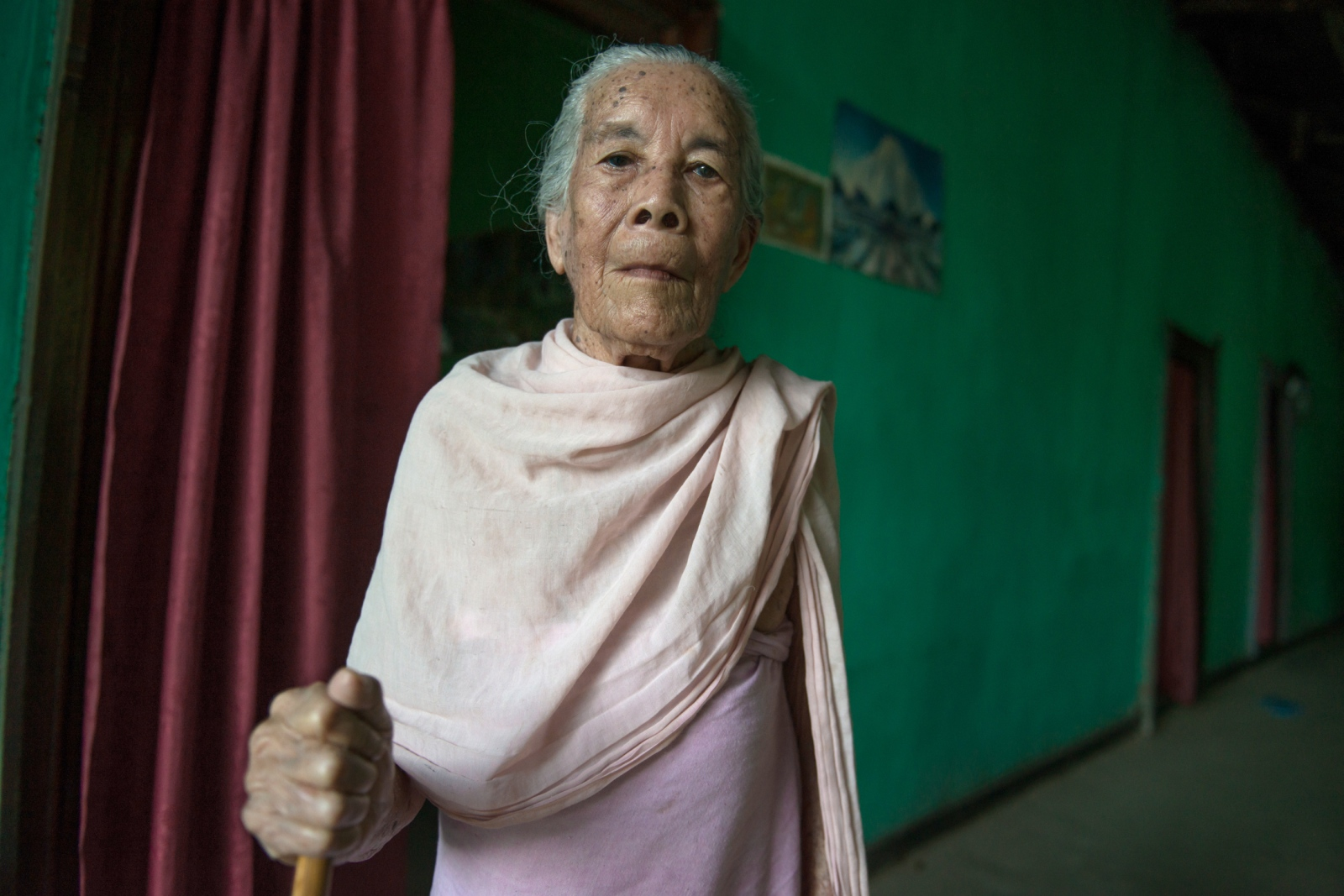 Sana Hanbi, a 92-year old resident of the village of Thanga Tongbram, poses for a portrait.