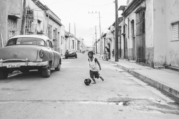 Kid plays in a street in the city of Matanzas   despite the popularity of this sport  finding a football in Cuba is anything but easy, included in the capital.