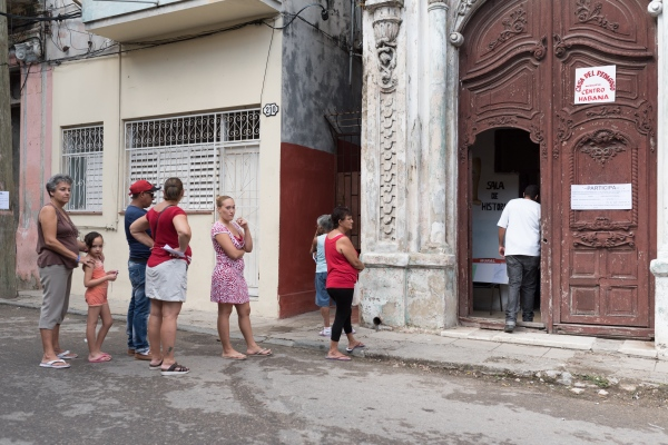 people in line at the polling station for the Cuban parliamentary election