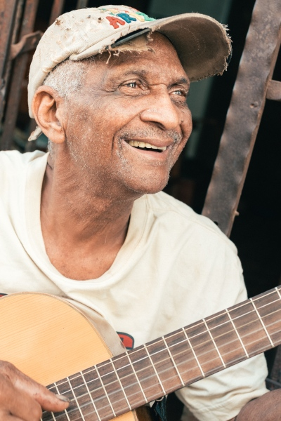 A gentle street musician in La Habana.  He has learned a little of Italian, a little of Russian and some Japanese words exclusively talking with tourists. For many years it was the only way for cuban people to know what was happening outside the island
