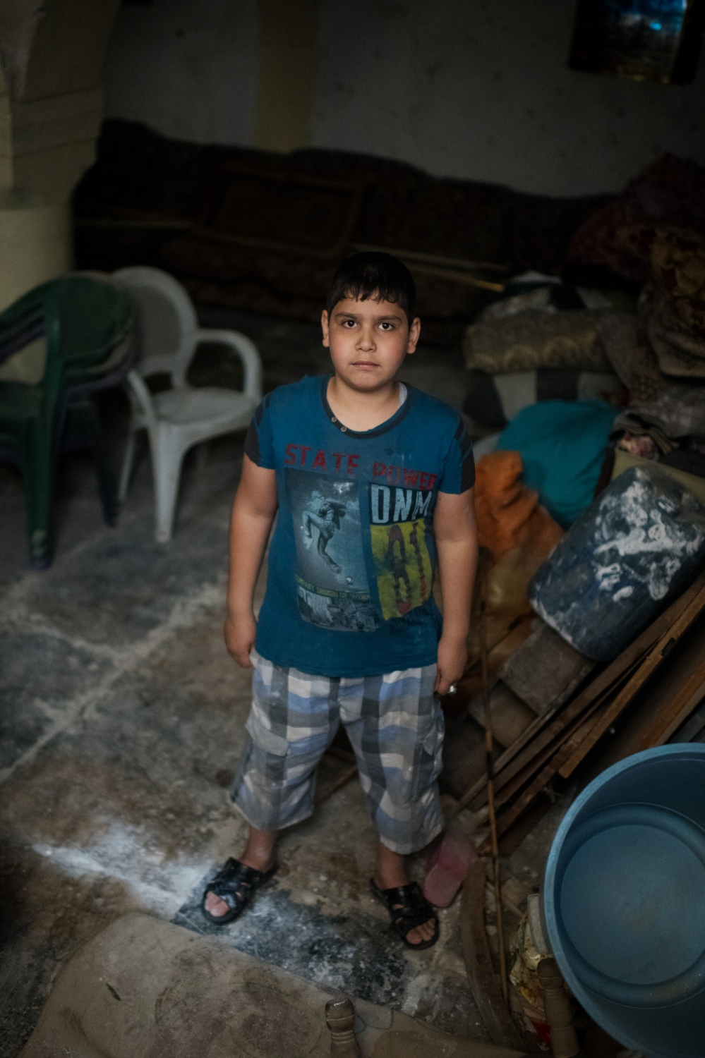 MOSUL 20180413 Jafar Helwan is 11. He is from old Mosul, the western part of Mosul. He lived here with five siblings, mother and father. His father is a day worker. Their house was partly destroyed by coalition airstrikes about a year ago. That was when Jafar got shrapnel in his shoulder and knee. He can still feel it in his shoulder. He has not been able to go to school for three years and works as a baker apprentice with his uncle. When we meet him he is visiting his uncle. What is your favourite thing? My bicycle. What do you like to do? I like to bake. What do you hate the most? I hate all the destruction. What do you want to be when you grow up? I want to become a baker. What is your dream? I would like to have my own home. Photo: Vilhelm Stokstad / Kontinent