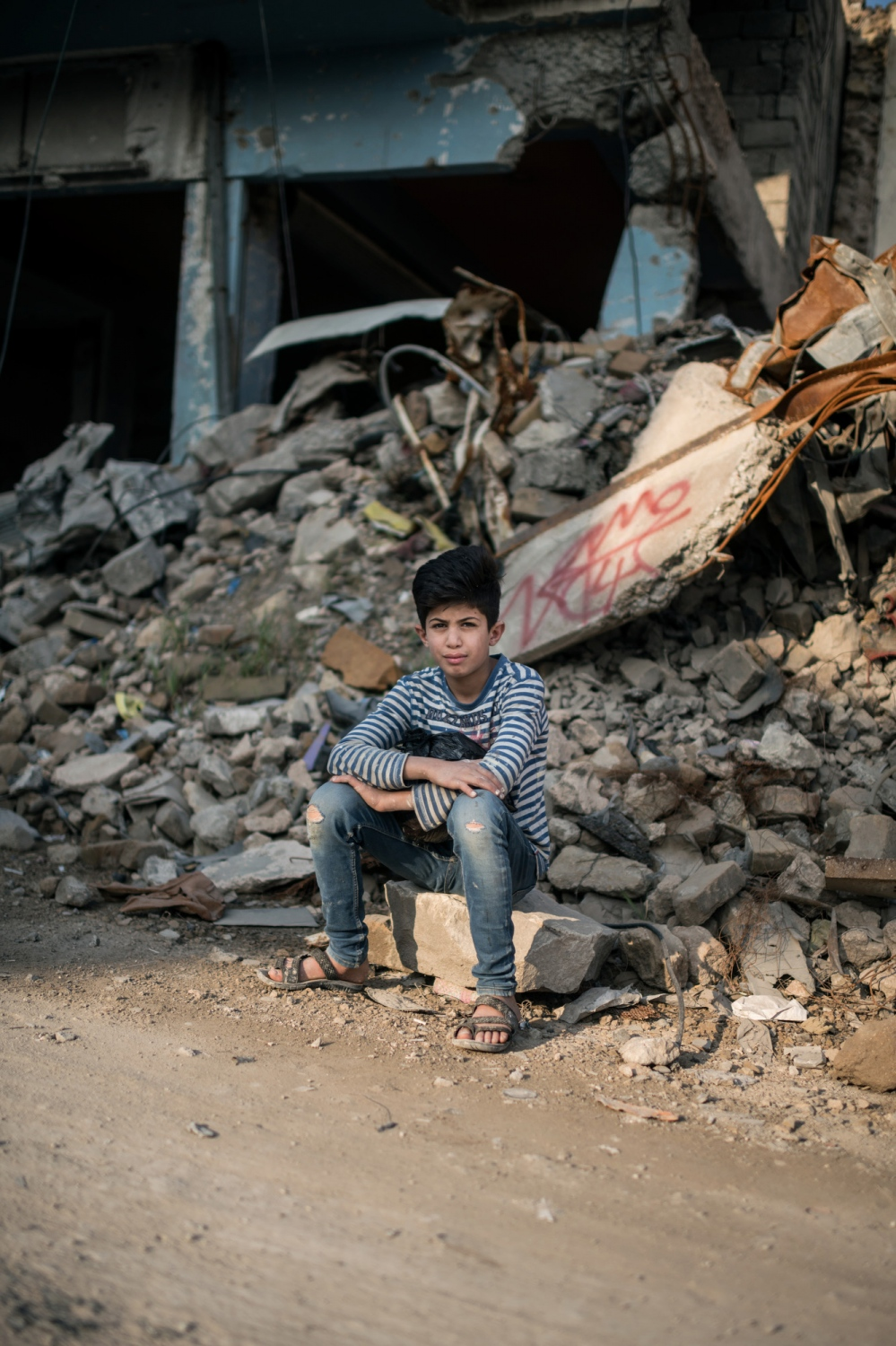 MOSUL 20180414 Mustafa Walid, 10, lives with his father, mother and three siblings. His dad is a painter and his mom a house wife. They used to live in old Mosul but had to flee to the eastern oarts when Daesh entered their neighbourhood. We meed Mustafa and his father in old Mosul. What is your favourite thing? I love my neighbourhood old Mosul. Why? It is our neighbourhood. What so special about it? It is my old neighbourhood. What do you hate most of all? I hate Al-eiser. (The name of the eastern part of Mosul). Why? The rents are high and the people is not very nice. What do you like to do? Work as a painter. To work with your father? Yes. What do you want to be when you grow up? A doctor. What do you dream about? To live in a castle. Where? Anywhere in Iraq, just not east Mosul. Photo: Vilhelm Stokstad / Kontinent
