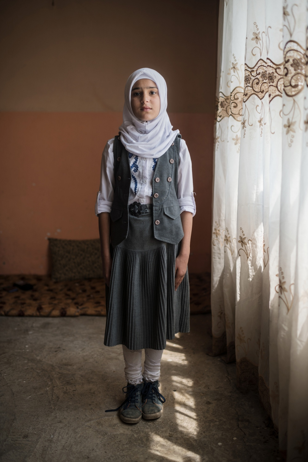 MOSUL 20180414 Ghuffran Ahmed, 12. Her family consists of nine girls and three boys. His mother is alive, but his father was taken by Daesh when they first took Mosul, they don't know if he is dead or alive. She lives with her uncle in the eastern parts of Mosul. We meet her in east Mosul. What is your favourite thing? My clothes, my laptop and my toys, but most of all the computer. I use it to play games and do homework. What do you like to do? I like to jump rope and to swim and to help mom and do my homework. What do you hate the most? I hate war and lies. What do you want to be when you grow up? I want to be a dentist. What are your dreams? I dream about finishing my studies. Which university do you want to attend? The Baghdad University. Why do you want to study there? Because it's a really good university. Photo: Vilhelm Stokstad / Kontinent