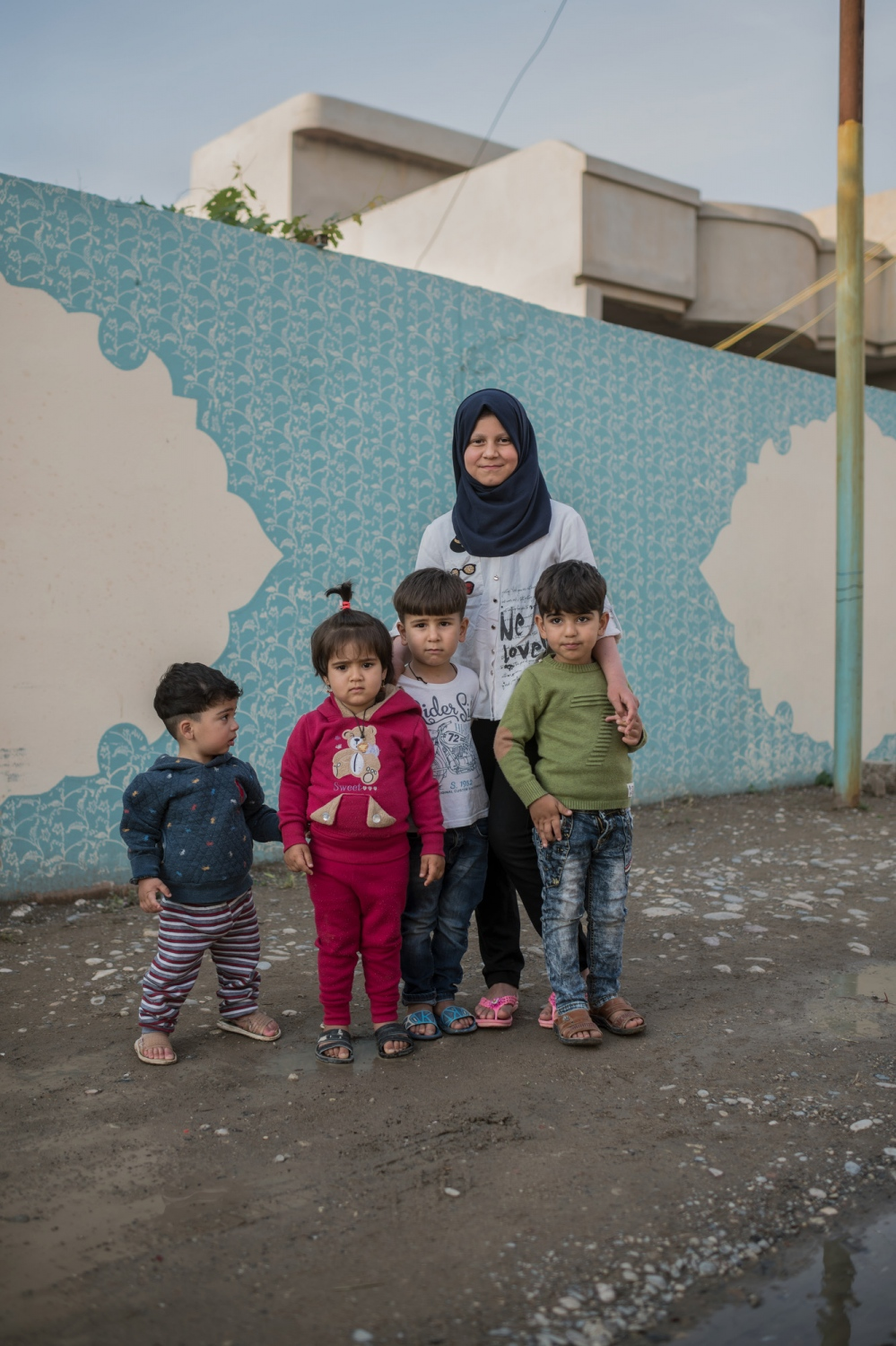MOSUL 20180413 Susan Khalouq Jawdat, 11 years old, with her siblings and cousins. She lives in the eastern part of Mosul with her mother, father and three siblings. Her dad is self employed and her mother a house wife. They had to flee when Daesh took their village in June 2014, when they came back all their things were gone or destroyed on account of Daesh occupying their house. We meet Susan in her home. What is your favourite thing? I had a doll that I loved. I got it from my father. But I lost it when we where on the run. What do you hate the most? All the destroyed houses. What do you like to do in your spare time? I like to play with my siblings and to paint and draw. What do you want to be when you grow up? I want to be a math teacher. I like mathematics. Do you like school? Yes I do. Do you have good grades? Decent, she shyly says. I have about 70 to 90 percent. (Iraq has a grading system based on percentages, where 100 is they highest grade). What are your dreams? I dream to grow up, become a teacher and help people. Who do you want to help? Those that are poor. You are 11 years old, what do you dream of in the near future? I dream about passing school. You have been forced to move a lot in the last three years, have you missed a lot of school? No. Was it hard to get new friends at school? The first weeks it was a bit hard to connect with, but the third week there was no problem. Photo: Vilhelm Stokstad / Kontinent