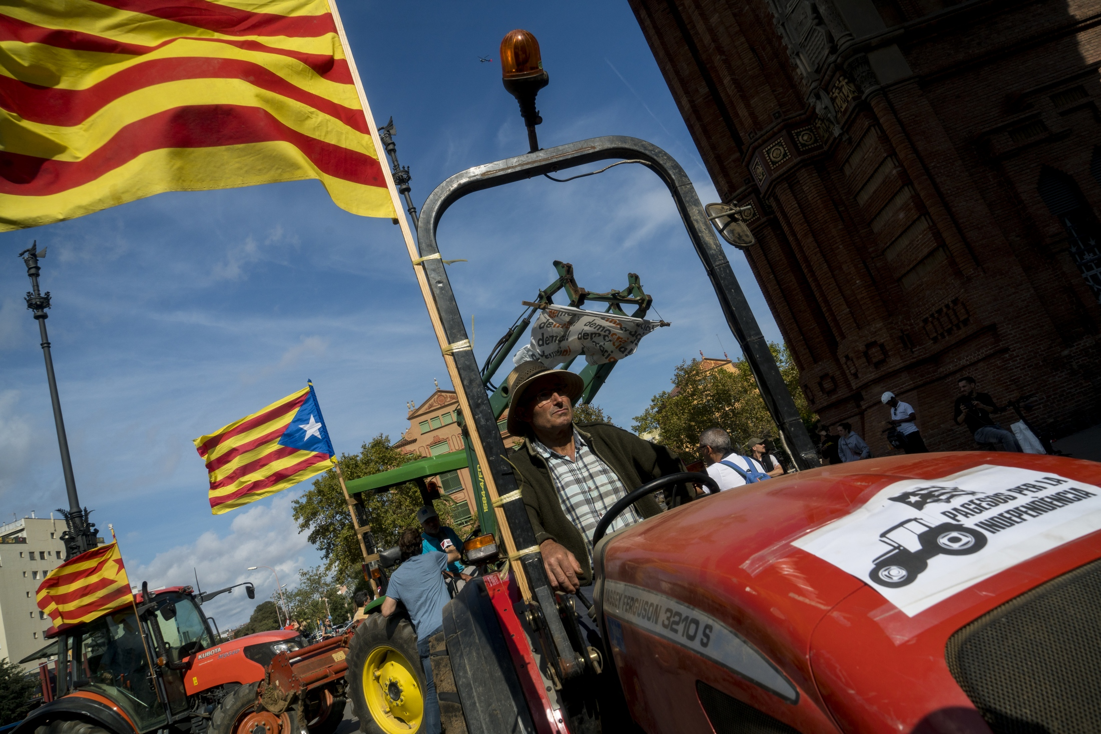 Farmers arrive at Barcelona's Arc de triomf, October 10th 2017. The farmers drove two hours from the Maresme region of Catalonia in anticipation of President Puigdemont's speech.