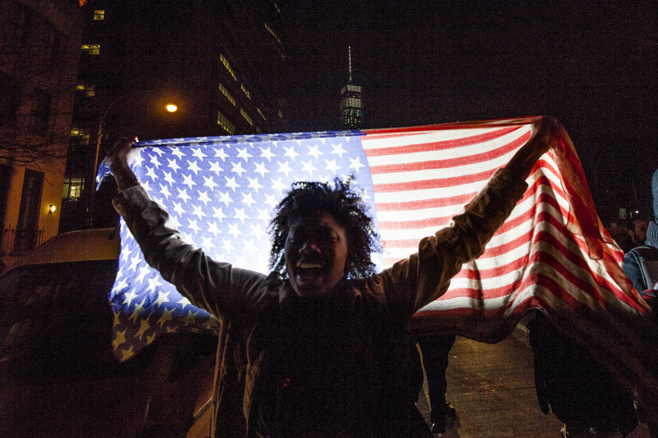 A protester marches up the West Side Highway, Nov. 26, 2014.