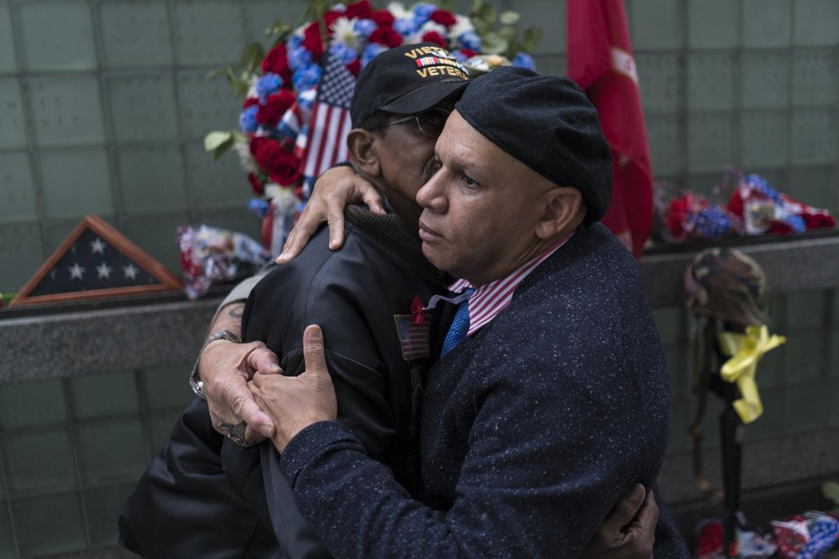 Darrel embraces fellow veterans on Memorial Day. New York City, 2017.