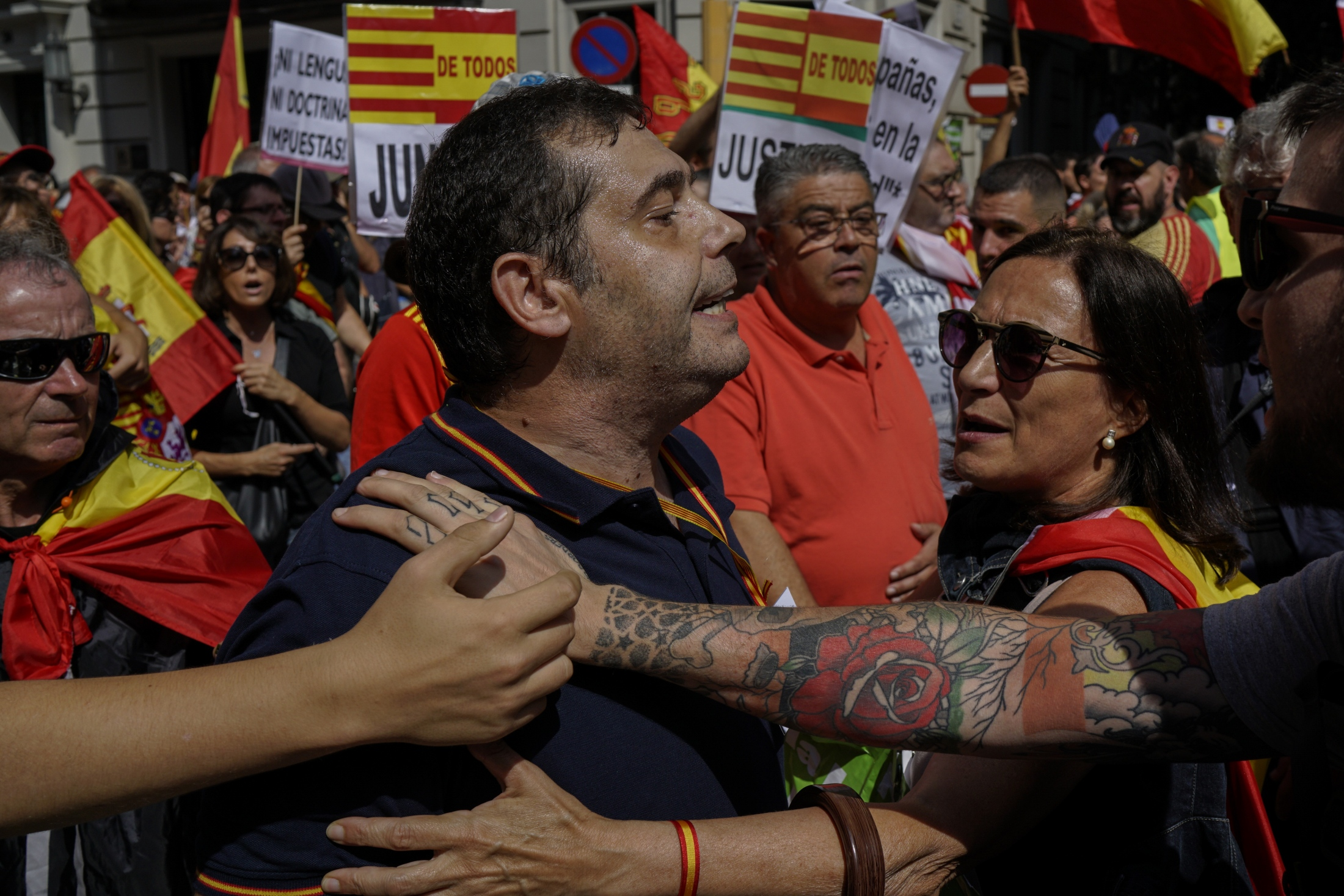 (AP Photo/Daniel Cole) A demonstrator supporting Spanish unity shouts slogans towards Catalonian separatists during a demonstration in Barcelona, Spain, Sunday, Sept. 16, 2018. Police in Barcelona had to intervene on Sunday to keep apart a group of Catalan separatists and a march of those who support Spanish unity. Police formed a barrier to keep the opposing groups from reaching one another when the separatists rallied in a downtown square where the march in favor of the increased teaching of Spanish in local schools had planned to finish.