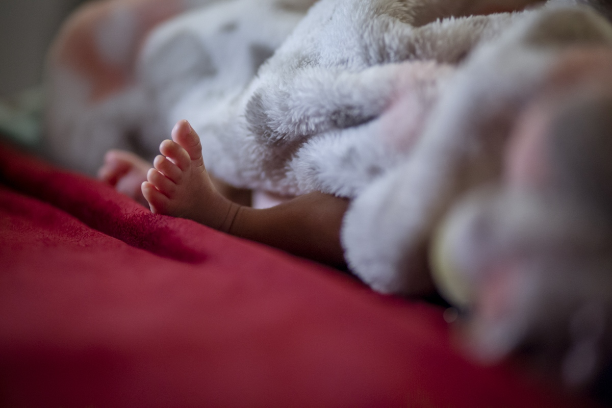Four weeks old Jovanna Medina, sleeps in her father, Julio Medina's apartment where he lives with his parents and brother in Sunset Park, Brooklyn, New York.