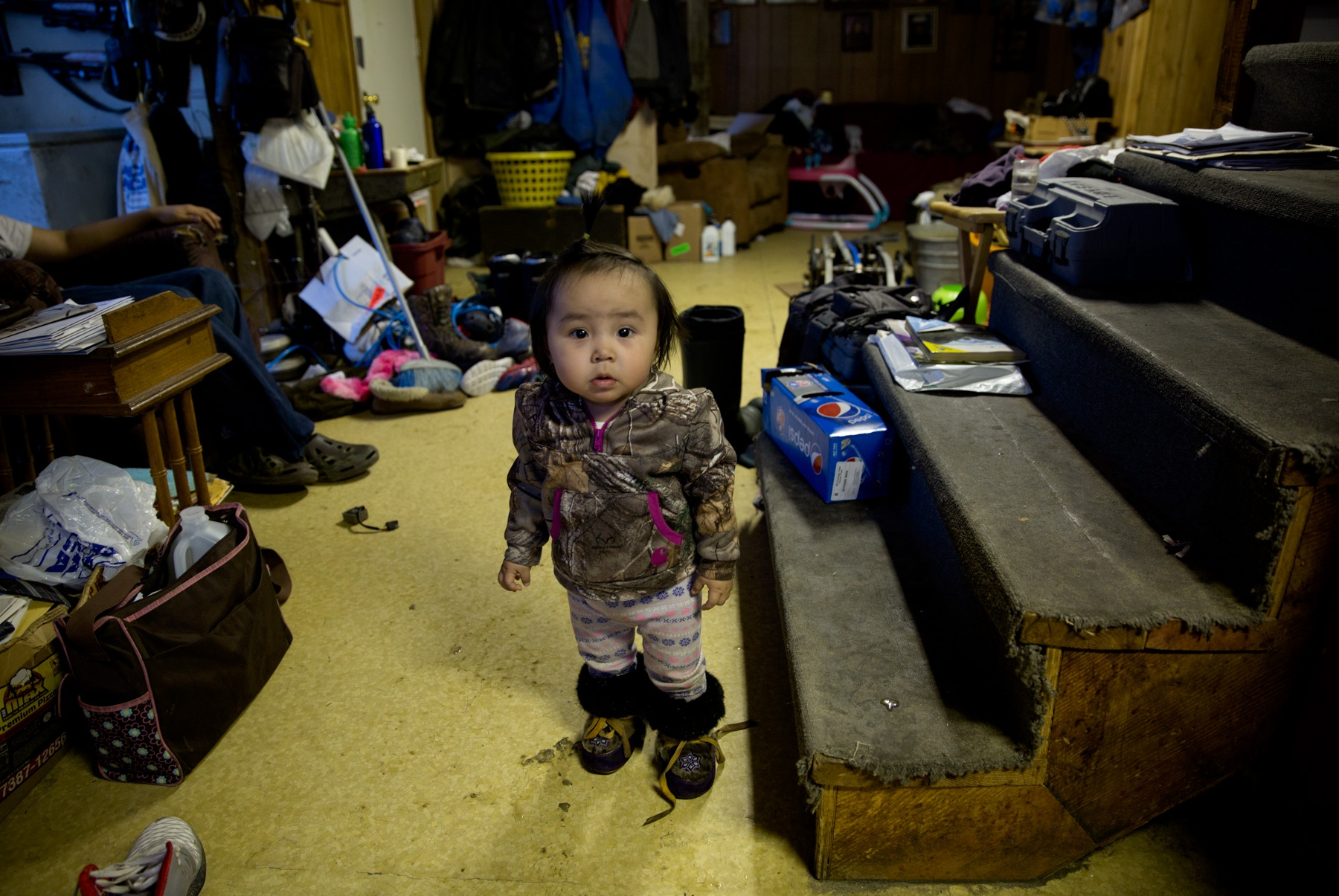 Marie, one year old, is one of the toddlers in Shishmaref, Alaska. Residents in Shishmaref, Alaska face an uncertain future. The island is sinking due to melting of the permafrost upon which it is located and the rising water levels due to climate change. Predictably, the Island will disappear within the next ten to twenty years. As of now, there are no solid plans for relocation of the village and its residents.