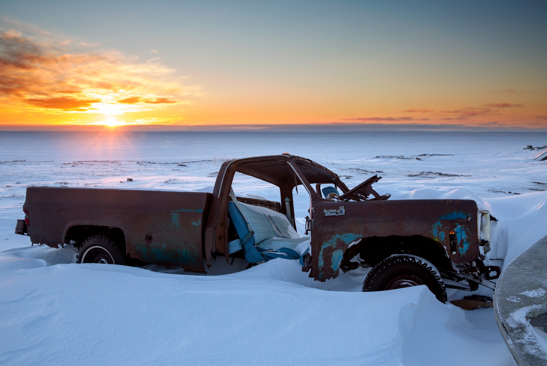 An abandoned truck in junked on the beach in Shishmaref, Alaska.