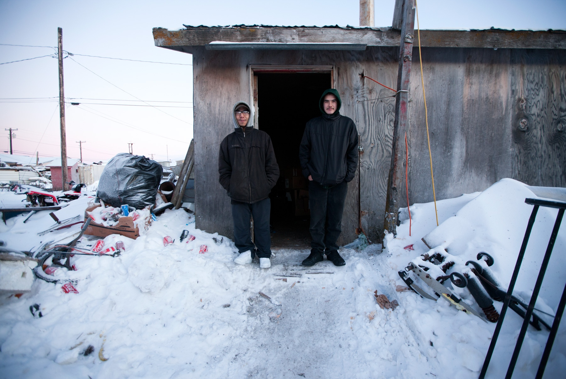 Brandon Naykpuk (left) and Justin Schultzi (right) were taking a smoke break in front of their workshop.