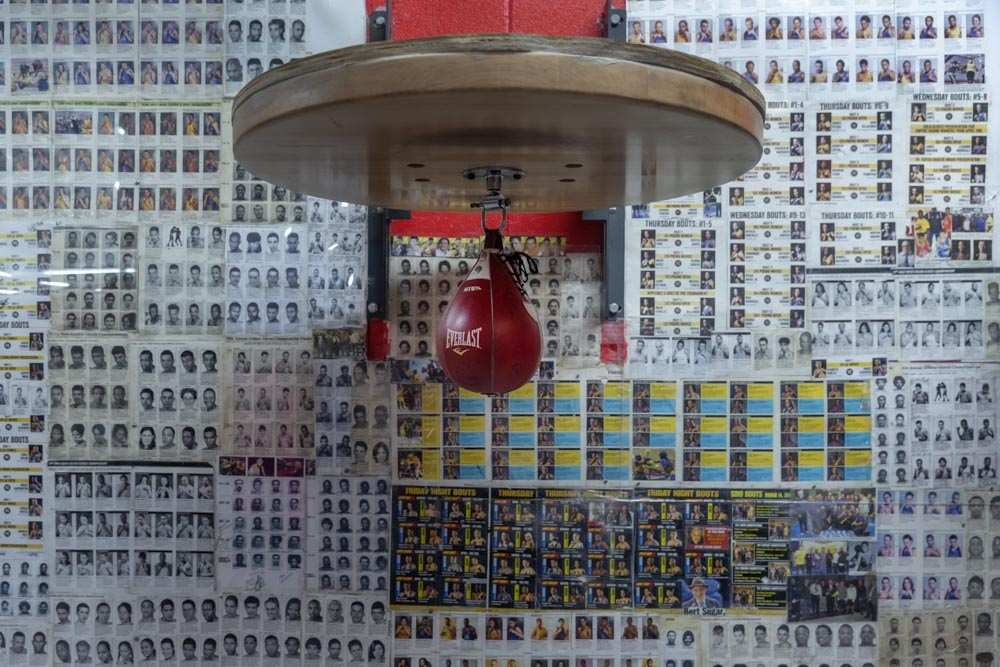 A speedball hangs against a wall of mugshots of champions who have trained at the Gleason's Gym.