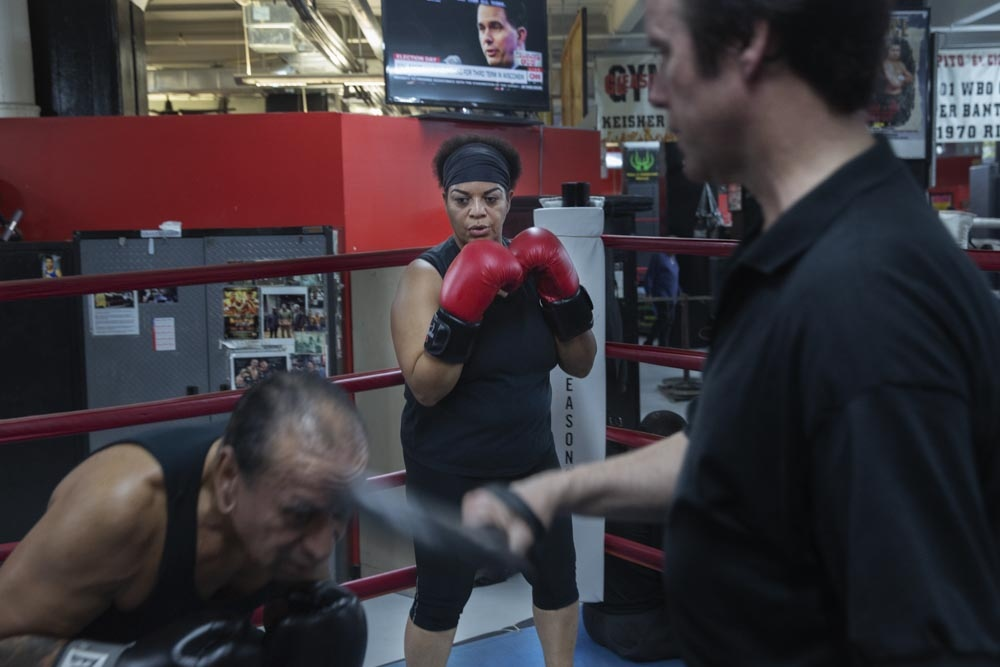 Yvonne Trinidad watches over while the coach, David Murray coaches her husband.