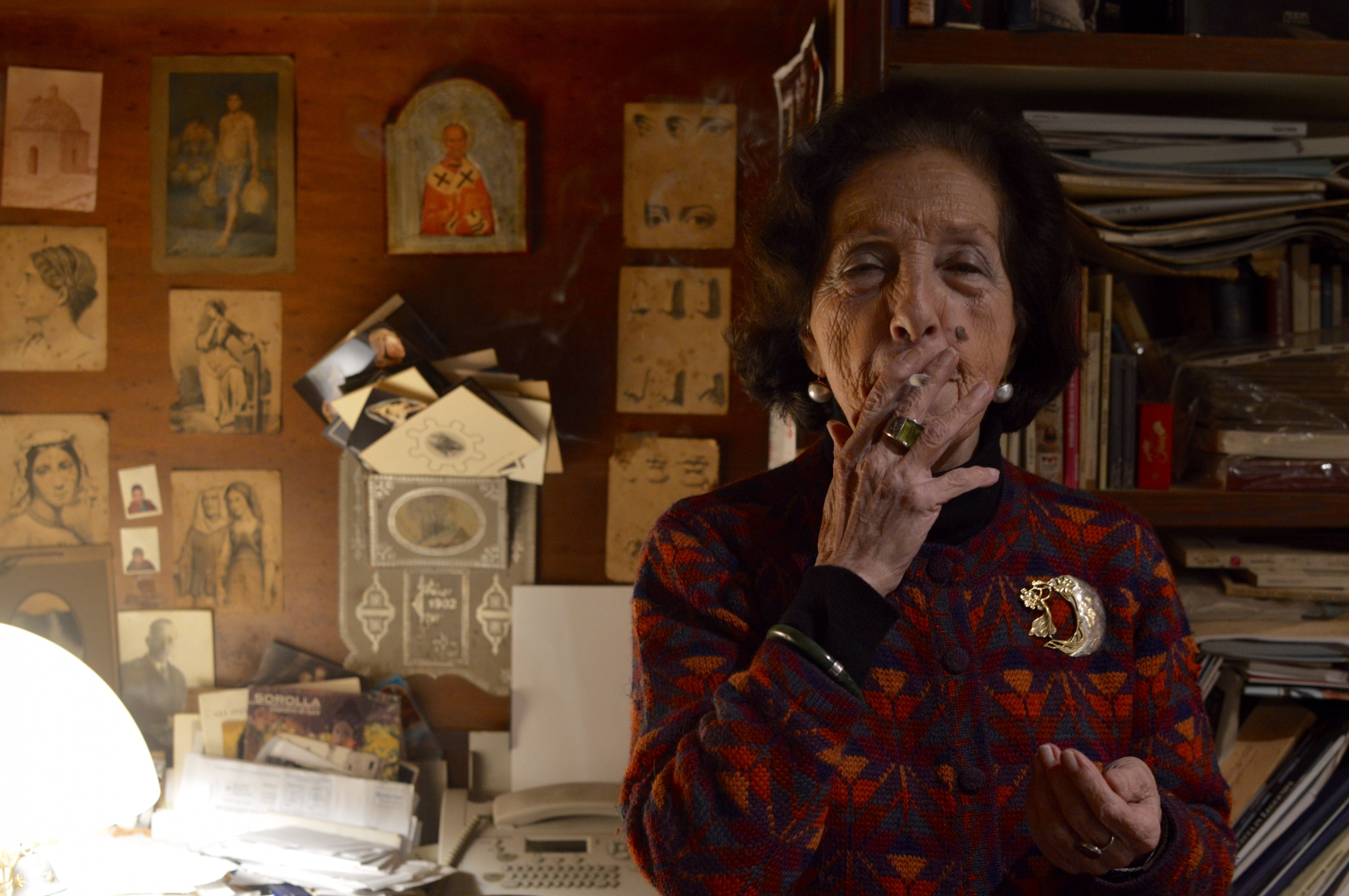 Mrs. Isabella, a 88-year-old lady who runs her little independent bookstore since 1979, smokes a cigarette as the end of a working day approaches, Bari, March 2019