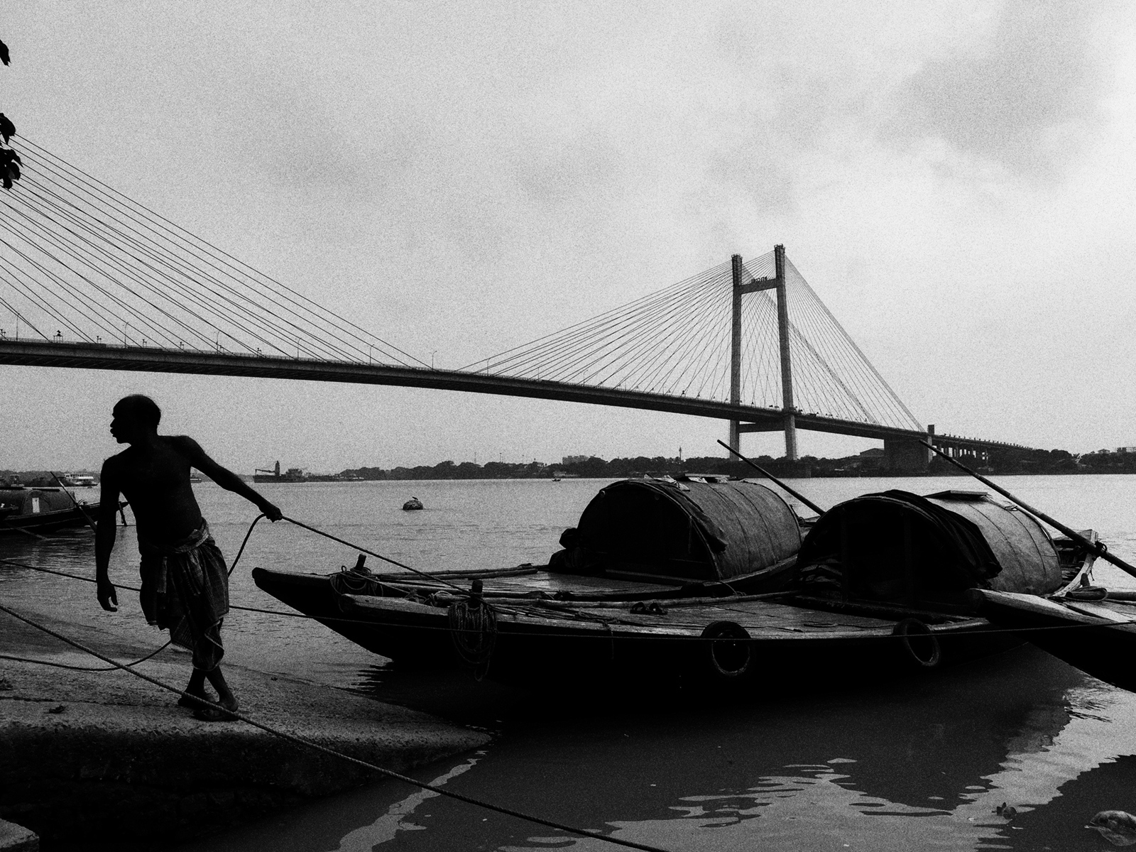 A boatman tends to his boat at Princep Ghat...