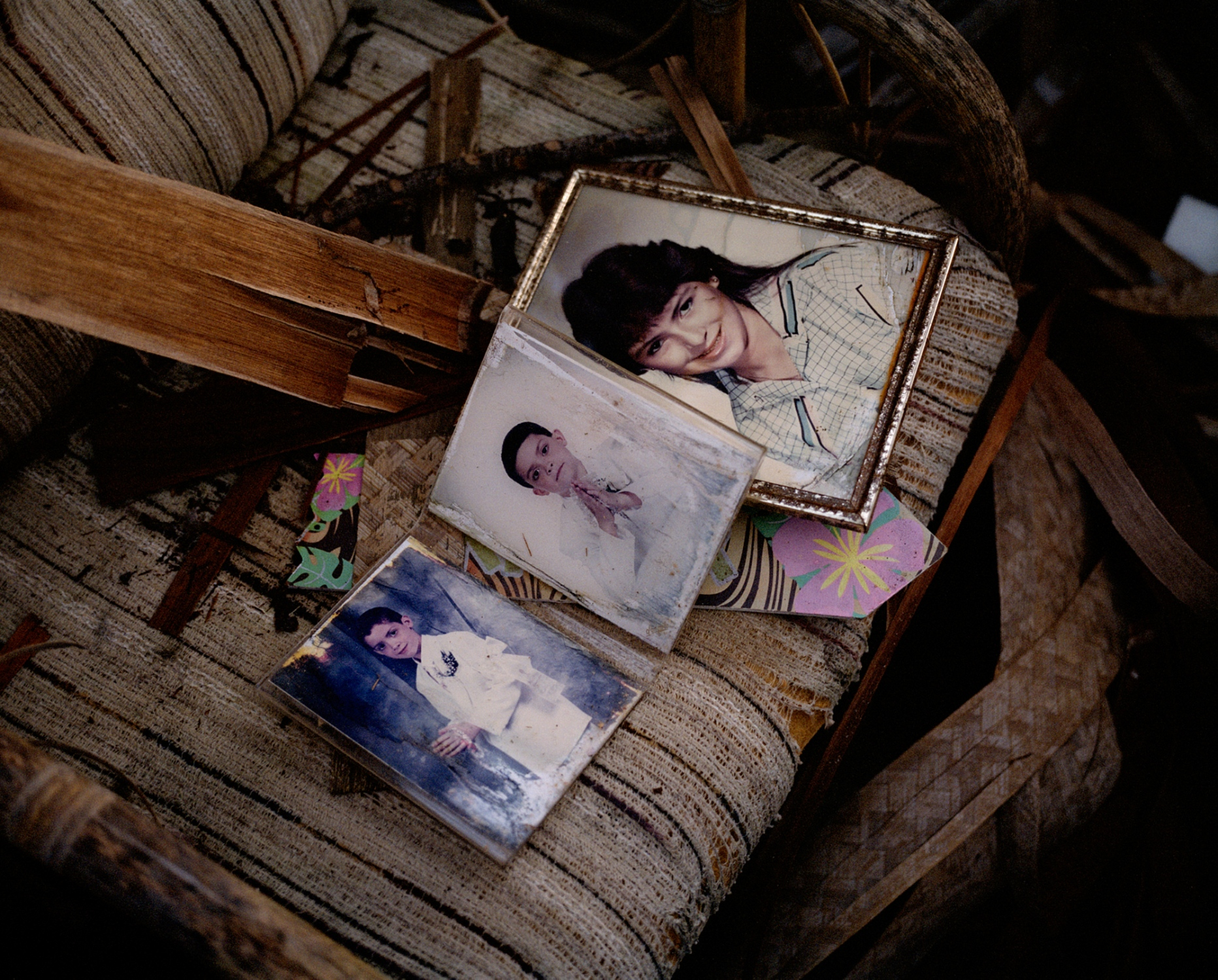 A photograph of myself, alongside photographs of my aunt Giacinia and brother Erik, sits on a couch amongst broken wood and glass in my grandmother Amparo's home. Villalba, Puerto Rico, December 2017.