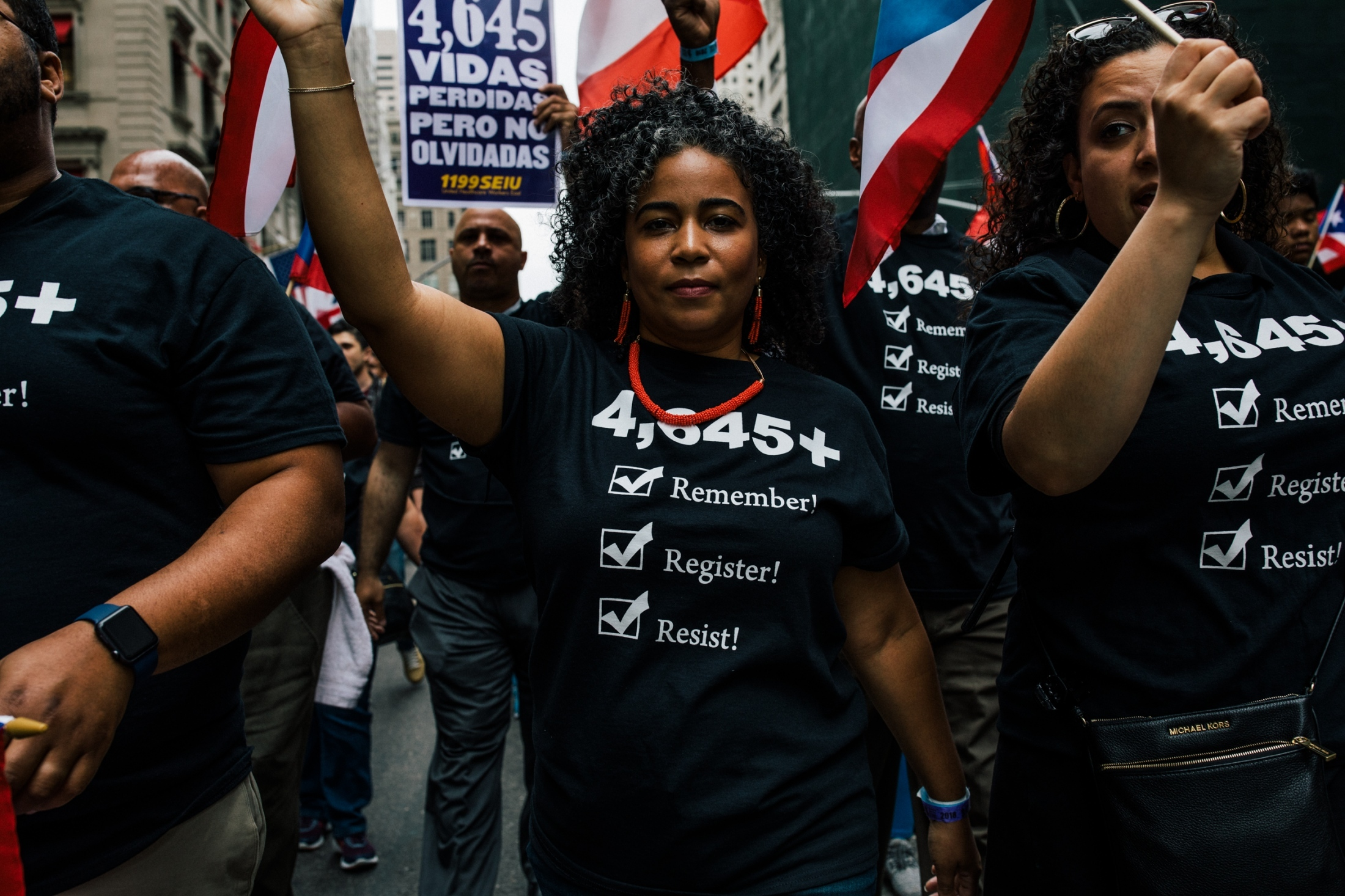 Marchers led by Rubén Díaz Jr., Bronx borough president, voice concerns about the recent death toll estimate and encourage the crowd to register to vote as they march on Fifth Avenue in Manhattan, New York, U.S. June 10, 2018.
