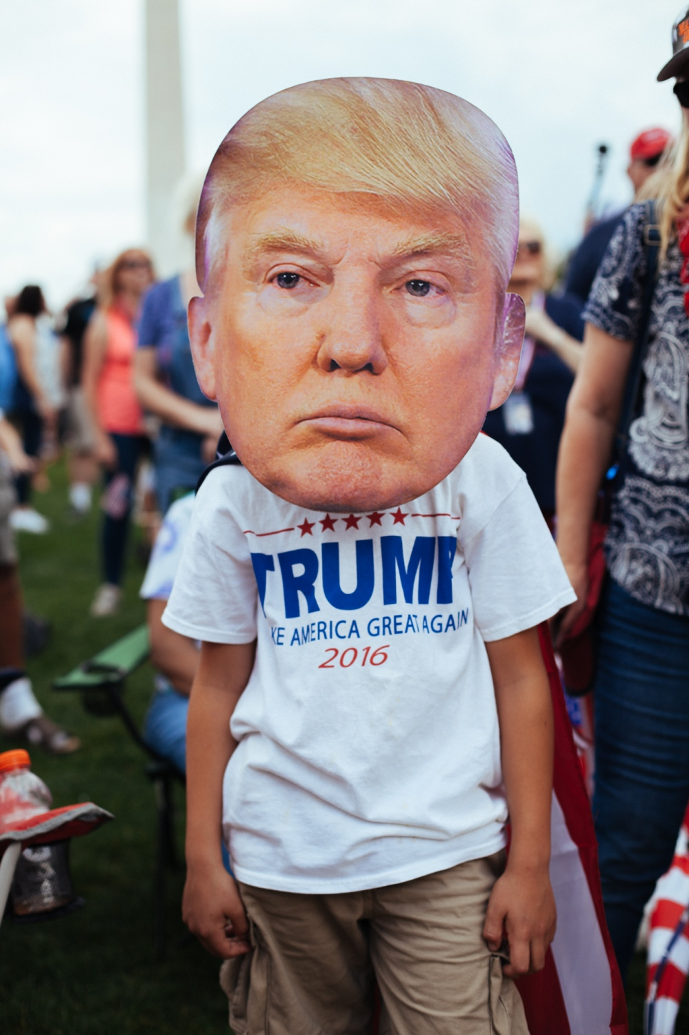 A young boy wears a cut-out Donald Trump mask during the #MOAR (Mother of all Rallies) demonstration at National Mall, Washington, D.C., U.S. September 16, 2017.