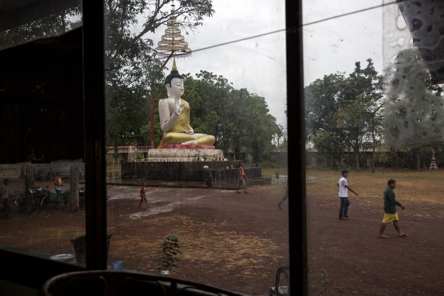 A village meeting of those who will walk the next day is held at a local temple in Wamon Niwat.