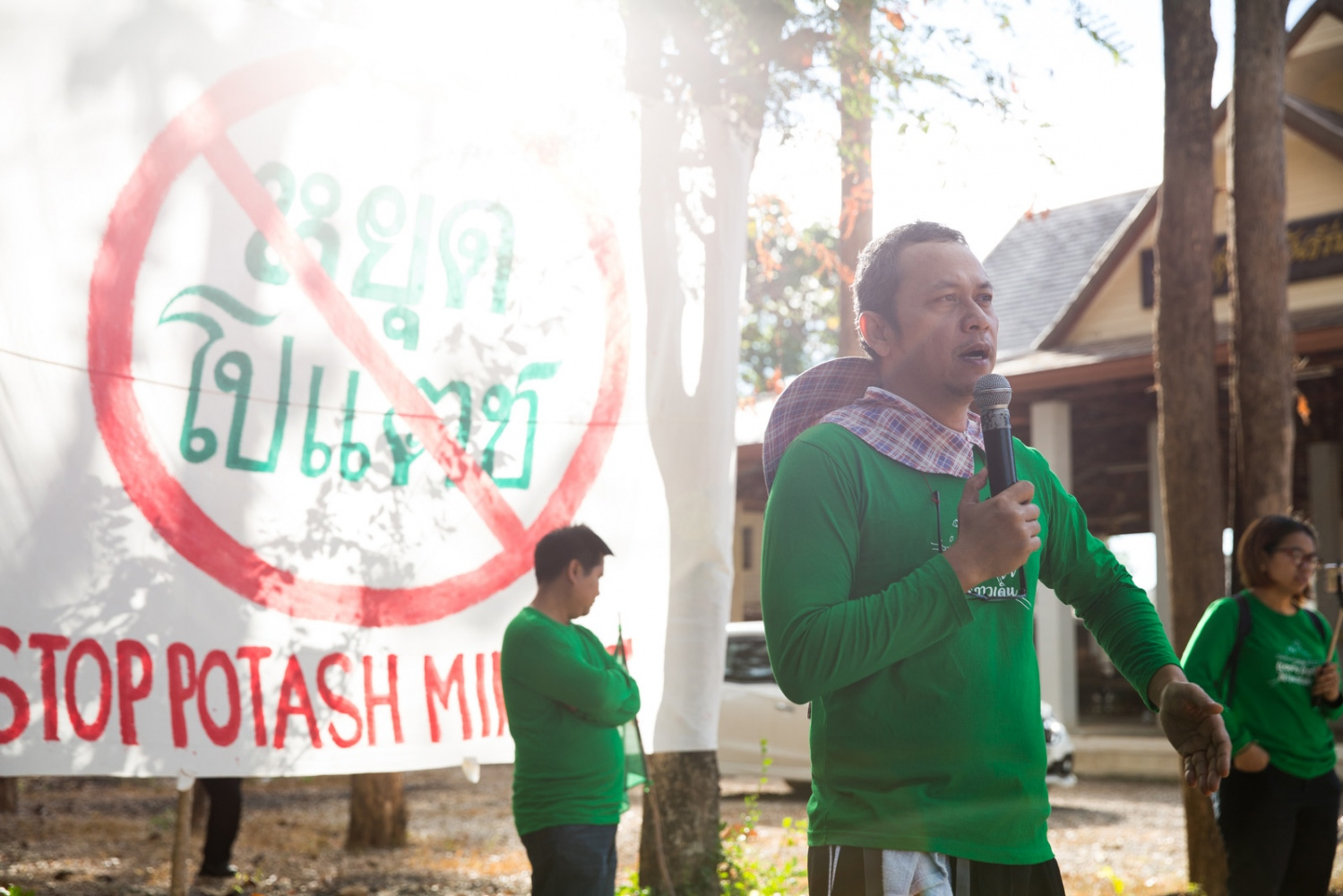 Lertsak Kumkongsak talks at the beginning of the walk to a crowd of around 200 people. He is one of the main organisers and an environment rights defender, who has been involved in community-based campaigns against the mining industry in Thailand for more than 20 years.