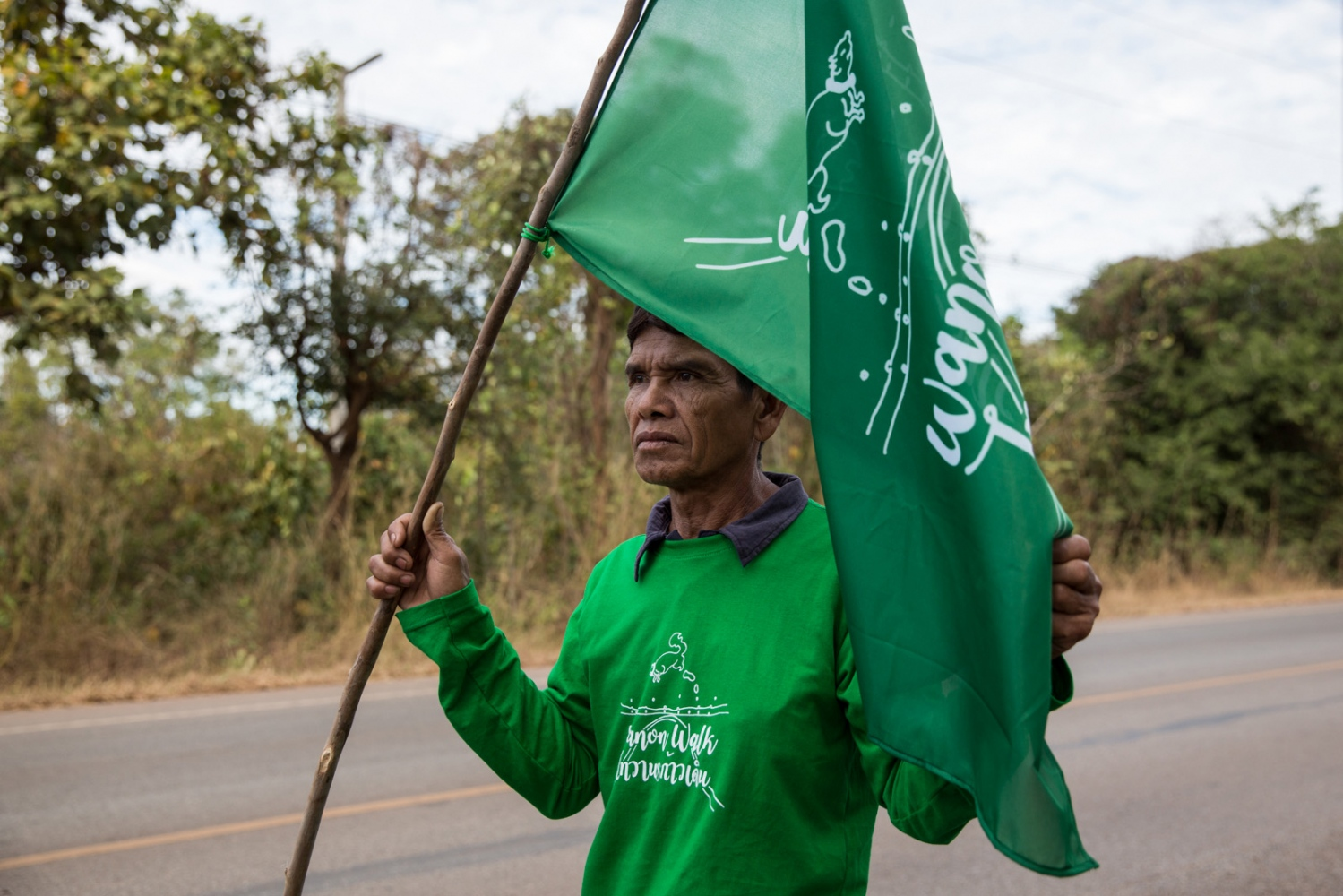 A villager member holds a Wamon Walk flag during the first day of walking in protest of a potash mining company.