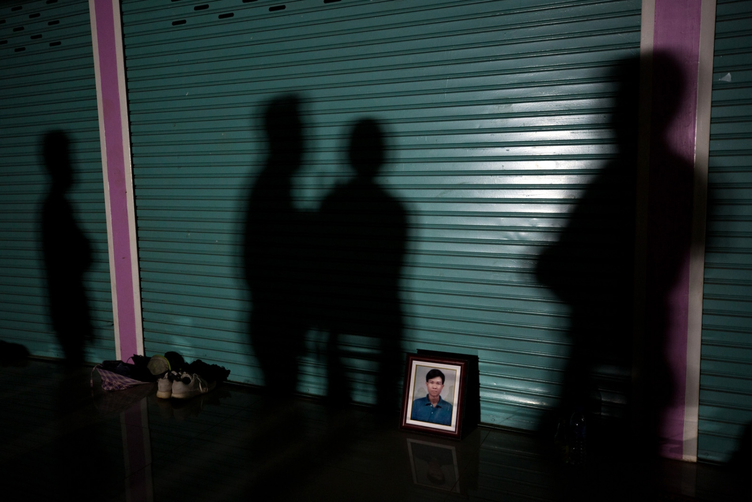 On day 4 the portrait of Nujiam Paisita, who was tragically killed in a car accident is placed against a door where the villagers will sleep for the night. The villagers and family members quickly held a ceremony for his death at his home and decided to carry his portrait every step of the way in his honour.