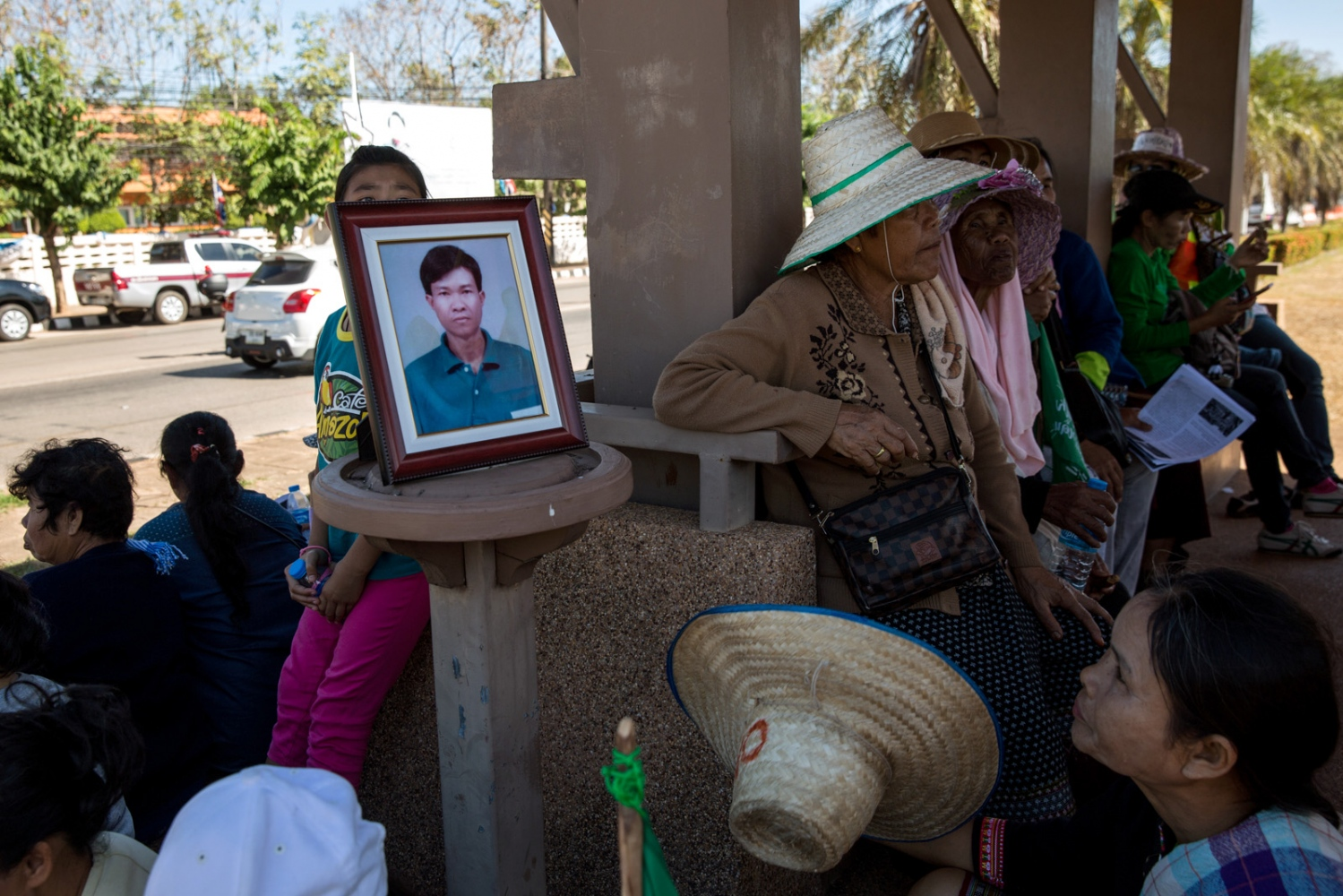 A portrait of Nujiam Paisita, who was tragically killed in a car accident the day before the beginning of the walk is placed carefully during a rest stop. The villagers and family members quickly held a ceremony for his death at his home and decided to carry his portrait every step of the way in his honour.