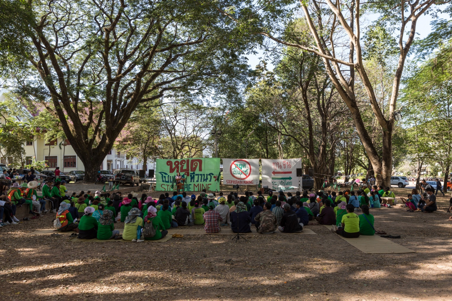 At their final destination of Sakhon Nakhon University over 200 anti-potash mining protesters sit and listen to visiting speakers from academia and anti-mining groups whilst closely watched by the authorities.