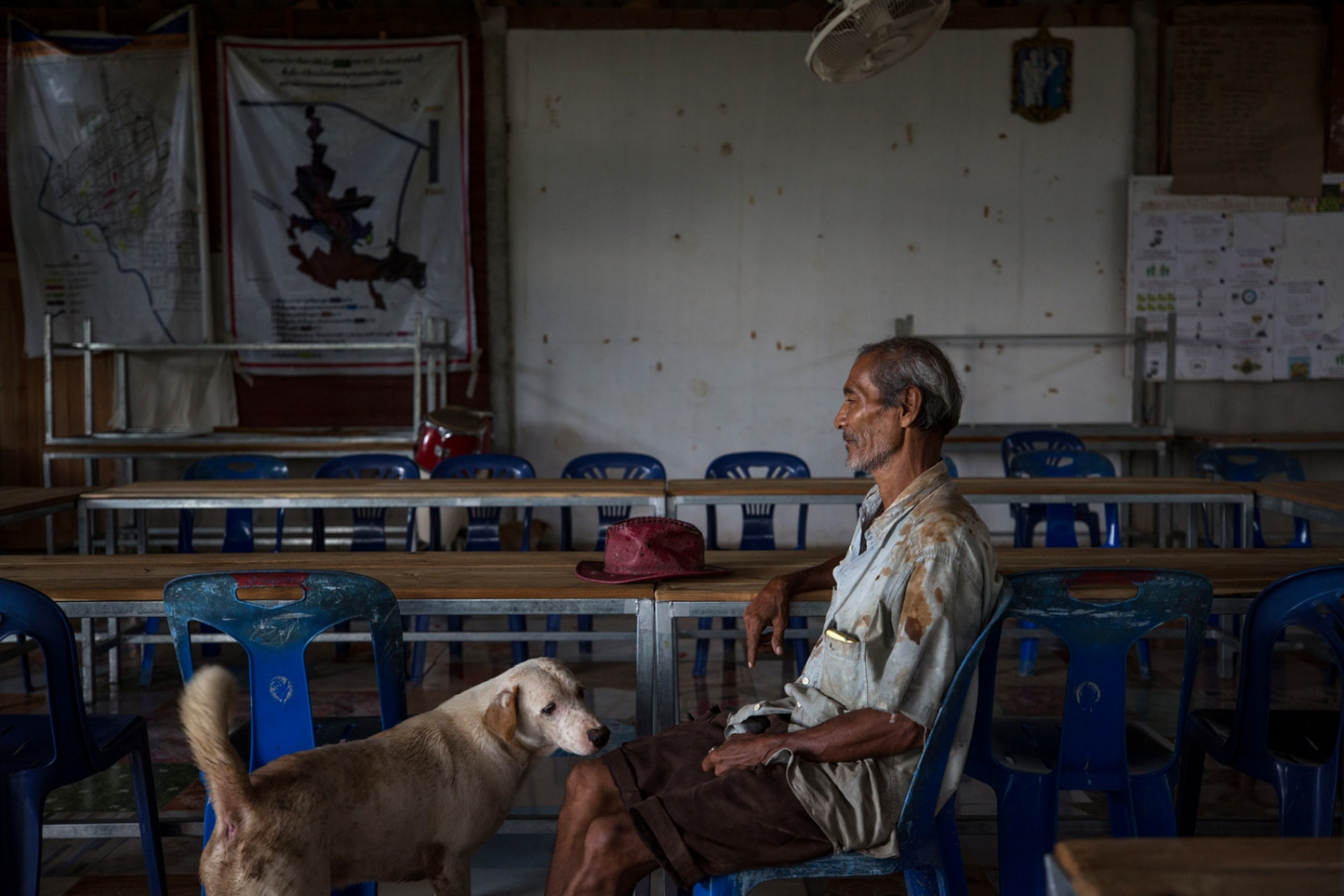 Pasit Bunban, a village elder of Klong Sai Pattana community takes a moment in the community hall located in the centre of the village. December 2018.