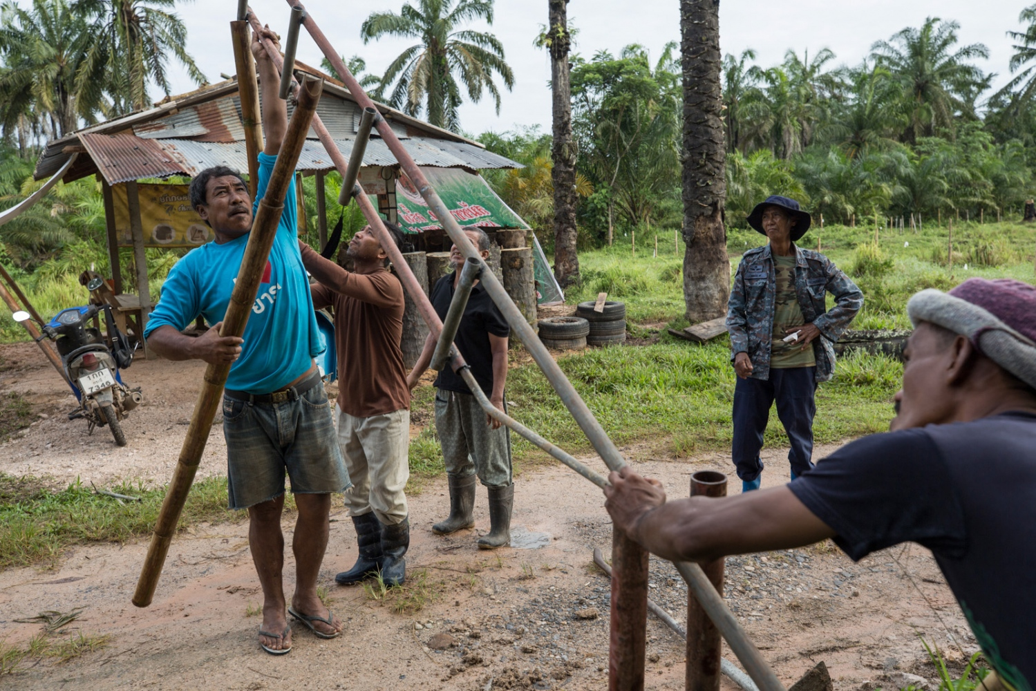 Locals of Klong Sai Pattana community erect a new security post and gate to the village. Safer that it was a few years ago the community has been able to expand its area for farming and also erect new security posts marking the new boundaries of their land. December 2018.