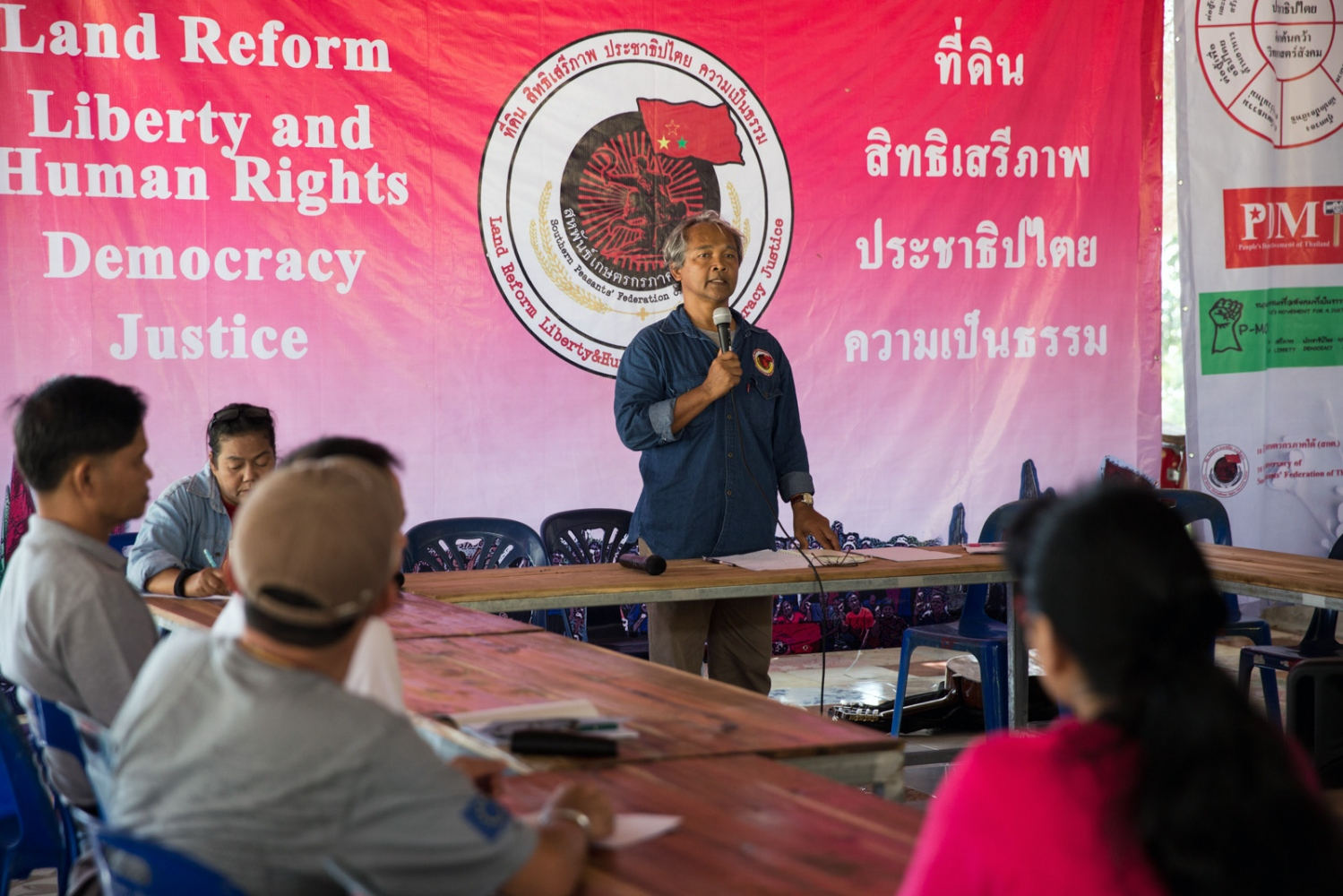 Pi Kaew, the leader of the Southern Peasant's Federation of Thailand (SPFT), leads a discussion forum during the 10 year anniversary celebration in Klong Sai Pattana whereby experts on human rights in Thailand and members of other Thai organisations talked and debated. December 2018.