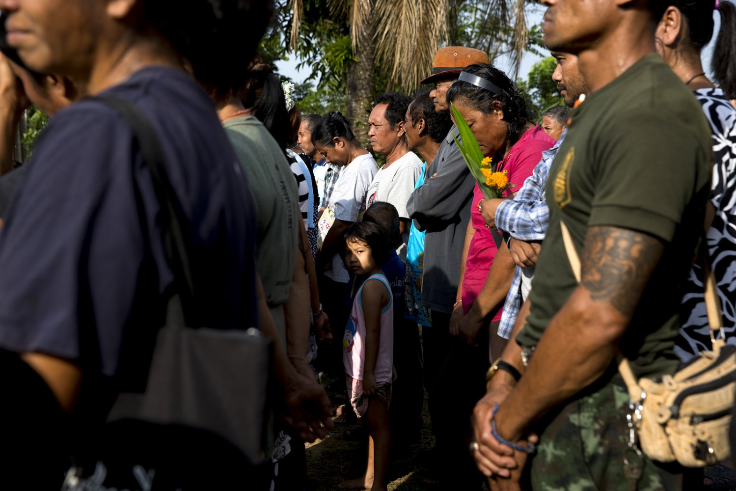 Villagers stand for one minute of silence on November 28th which marks the memorial day of Klong Sai Pattana village for each of the four people murdered during their prolonged fight to remain on the land. On 11 January 2010 Mr Somporn Pannapum who was shot dead whilst having dinner at his home in the village itself. Then on the 19 November 2012 Mrs Montha Chukaew, aged 54, and Mrs Pranee Boonrat, aged 50, were shot and killed while they were on their way to a local market. And then on 11 February 2015, Chai Bunthonglek was shot dead at his house by two gunmen.
