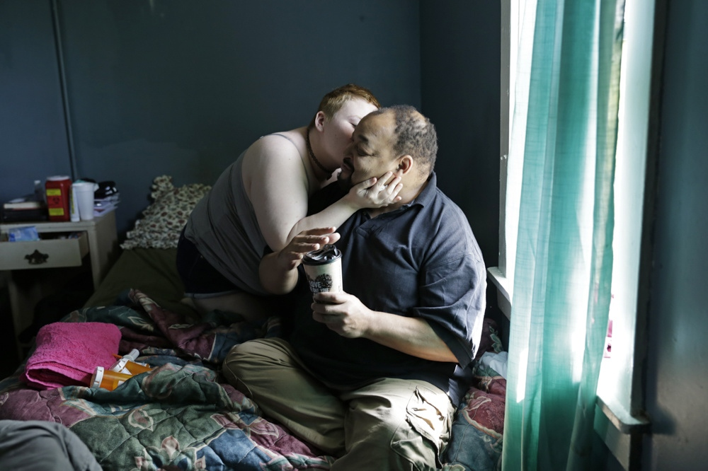 Angel Davis kisses her boyfriend David Nelson at the Travel Inn Motel in Cave City, Ky. After meeting at a homeless shelter in Illinois 2 years ago, the couple moved to Bowling Green, Ky. in hope for help from Angel's family who lives in Caneyville, Ky.