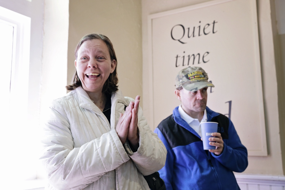 Laurie Brown cheers for a person ringing the church bell at Hotel Inc. (Helping Others Through Extending Love in the Name of Christ), a prominent homeless services center in Bowling Green, Ky. The bell is rung when a person has found permanent housing.