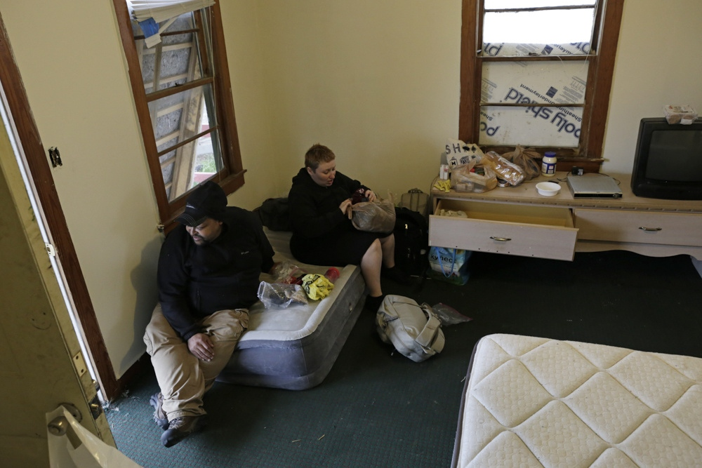 David Nelson and Angel Davis review some of their belongings as they move into Park Cozy Apartments in Cave City, Ky. with Laurie Brown and Michael Brady.