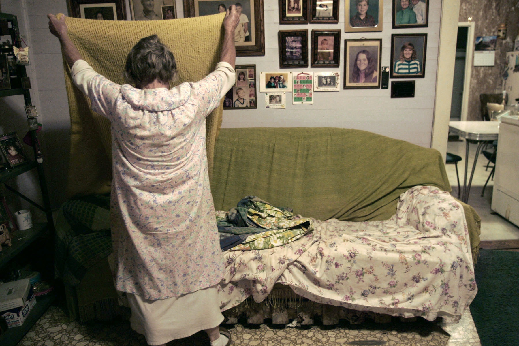"Louise Buntain makes her bed in the morning. She and husband Bert have slept in different beds in the same room since 1983. ""It's a small bed. Just got in the habit. He wiggles. I wiggle,"" Louise said and laughed."