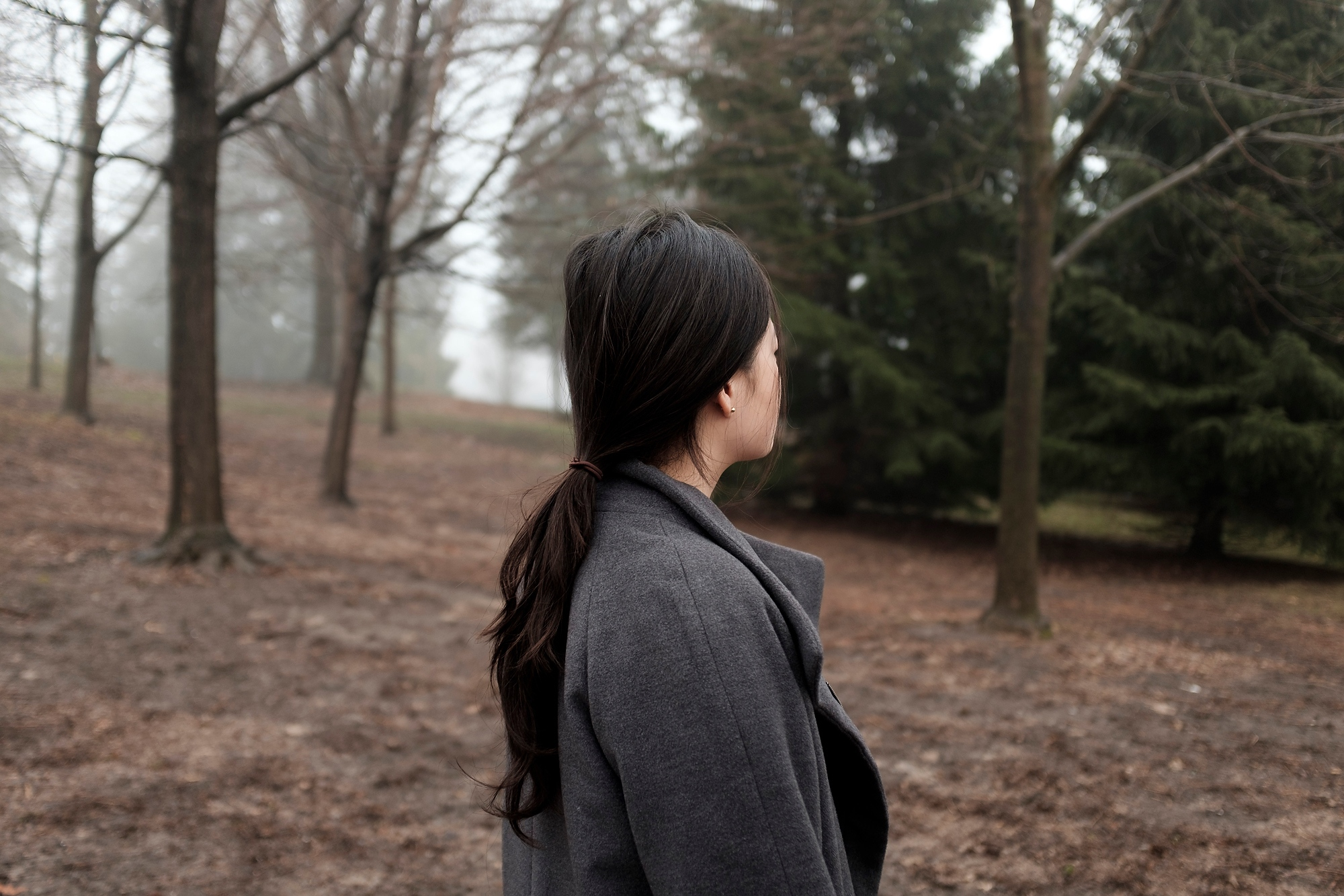 "E.L. stands in a local park in Waterloo, Ontario in April 2017. E.L believes she has borderline personality disorder. She only recently started to see a counsellor at the university. ""I felt lonely growing up because of mood instability. So I resorted to self-harm. It felt like I could drop everything and I could focus on one feeling which was physical, instead of the inner emotions which were harder to deal with and control. No one ever just does things. You can't analyze surface level things. There's probably something deeper going on with someone."" April 2017"