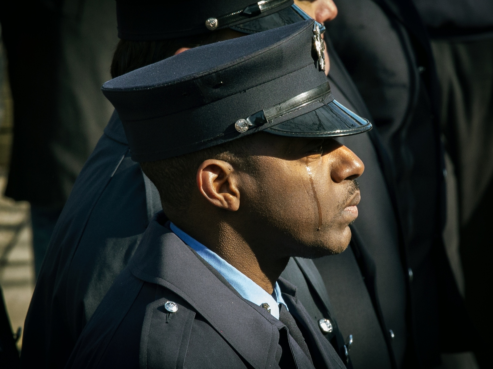 Photography image - A FDNY firefighter cries at the funeral of Steven Pollard who fell to his death on Sunday from the Mill Basin Bridge after responding with his company to an overturned car. Funeral was held at Good Shepherd Church in Brooklyn on January 11, 2019