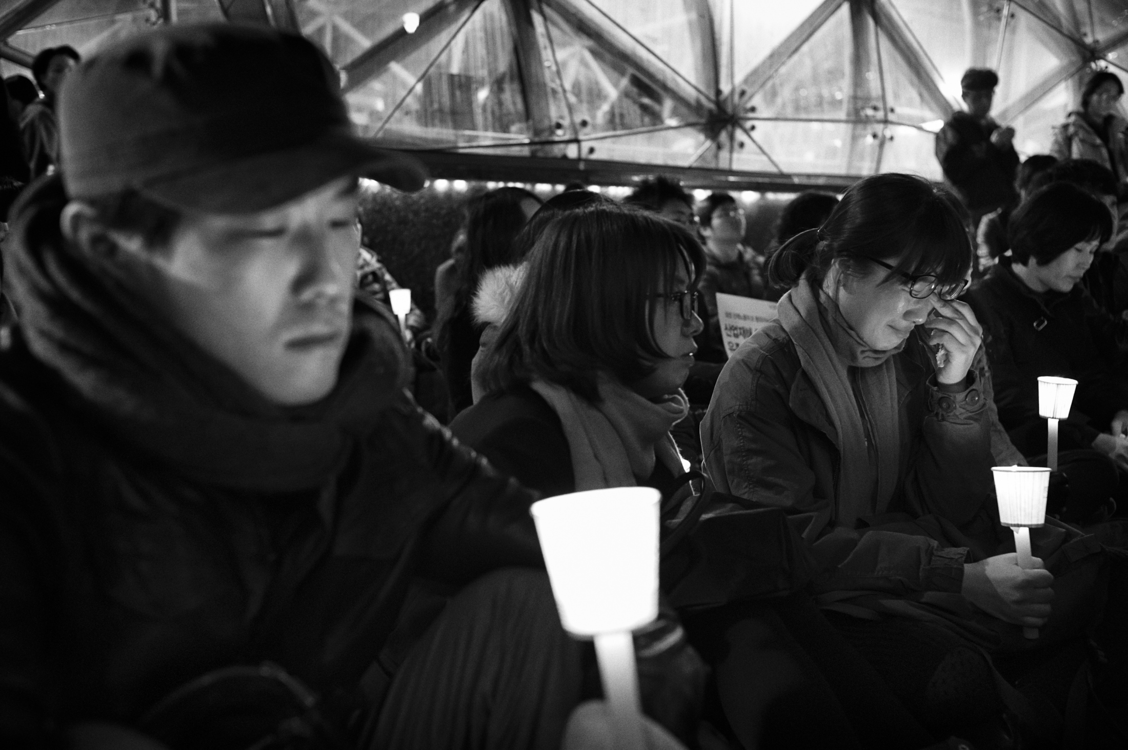 Victims' families and a group of people attend the memorial ritual for the deceased former Samsung Electronics factory workers in front of Samsung Town Headquarters in Seoul, South Korea on Mar. 6, 2013.