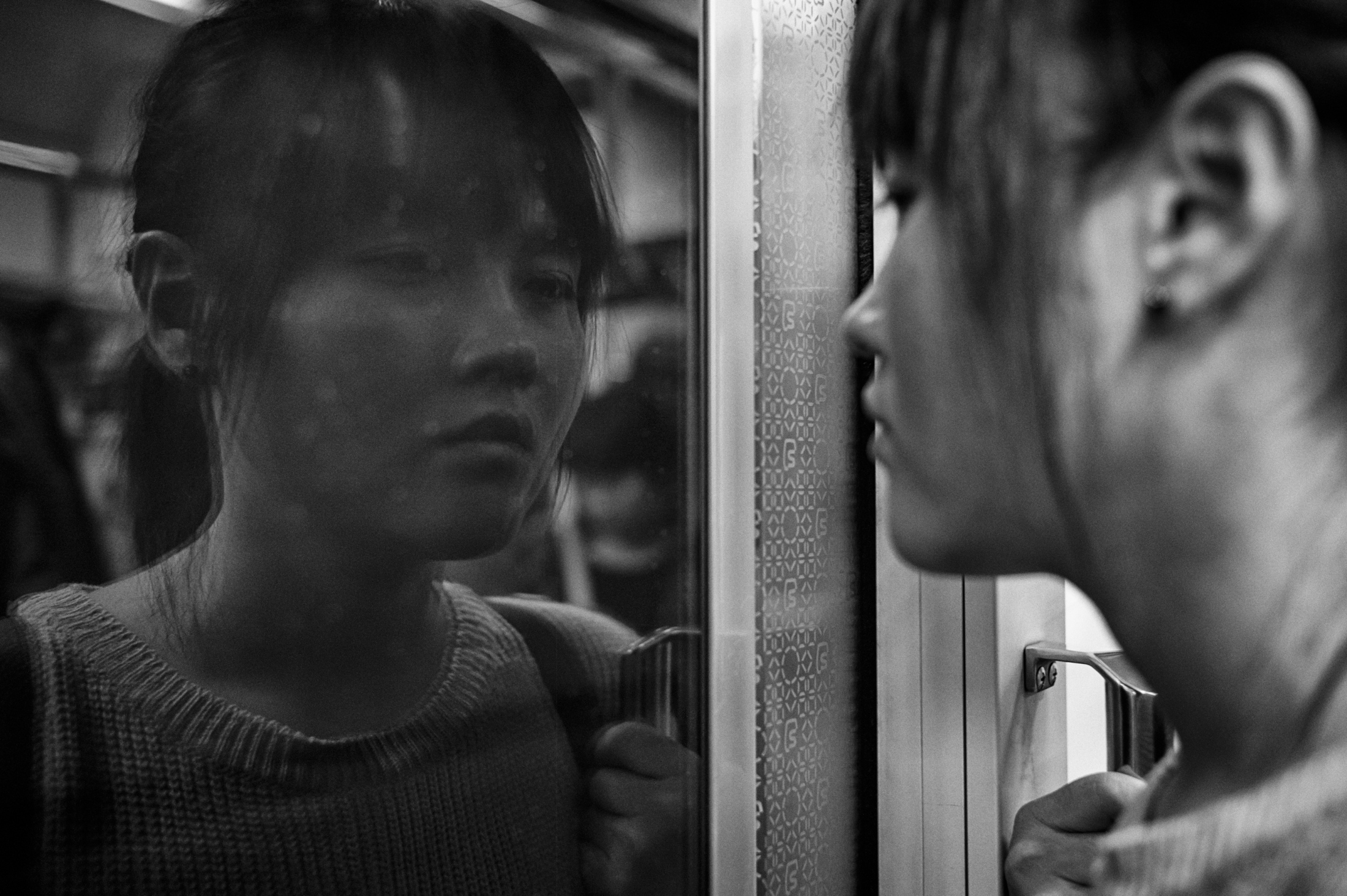 Kim Mi-seon stands and holds a grip in a subway train on her way to a barista training center for the blind on Oct. 21, 2013 in Seoul, South Korea. Mi-seon worked at Samsung Electronics LCD factory in 1997, and had diagnosed with multiple sclerosis in 2001. She also got a visual impairment as a side effect of her disease. She applied for industrial accident compensation insurance and pension to COMWEL, Korea Workers' Compensation & Welfare Service in 2011, and after years of struggle at the court against COMWEL and Samsung, she won her case on Feb. 10, 2017.