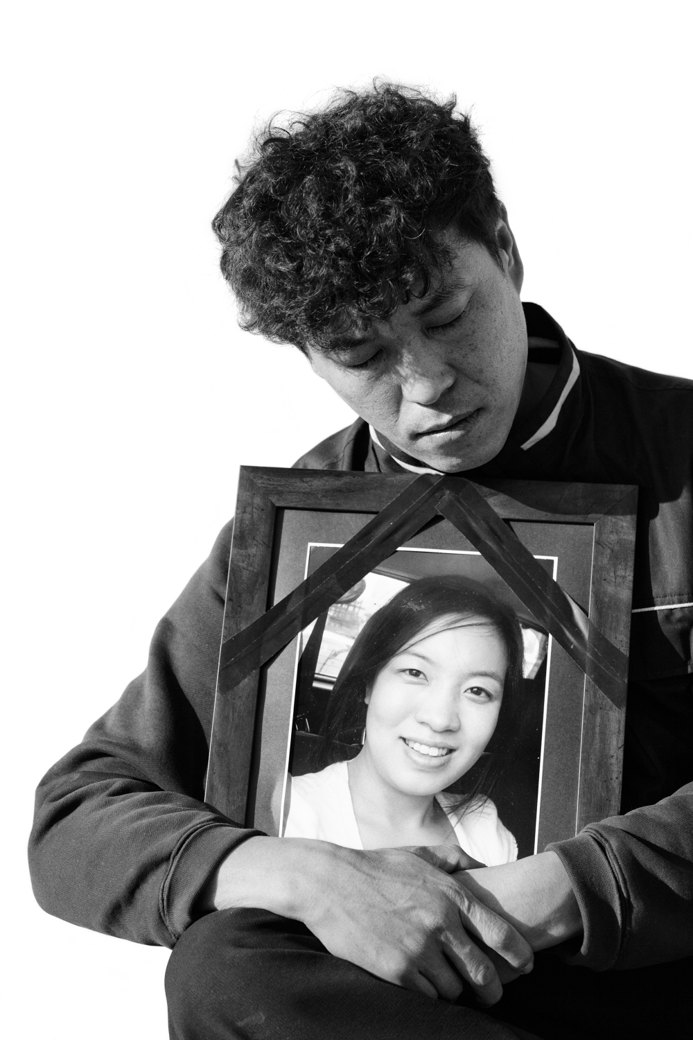 Chung Hee-su holds a portrait of his deceased wife, Lee Yoon-jung in Bucheon, South Korea on Nov. 7, 2013. Lee Yoon-jung worked at Samsung Electronics semiconductor chip factory in South Korea from 1997 to 2003. She died of a brain tumor in 2012. He applied for industrial accident compensation insurance and pension to COMWEL, Korea Workers' Compensation & Welfare Service in 2011. After long struggles and debates,  The Supreme Court of South Korea sentenced that the brain tumor caused Lee Yoon-jung's death is work-related on Nov. 14, 2017. It was the first case that The Korean Supreme Court recognized a brain tumor is an industrial accident from a semiconductor chip factory.