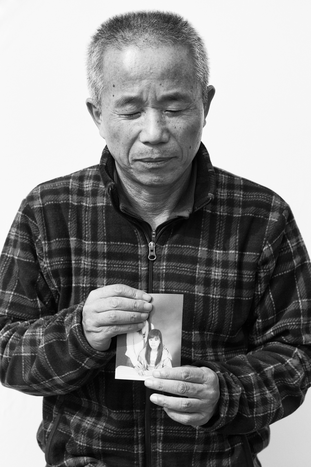"Hwang Sang-ki holds the picture of his late daughter, Hwang Yu-mee in Sokcho, South Korea on Apr. 11, 2014. Hwang Sang-ki is the very first person who started the struggle against Samsung Electronics right after his daughter's death in 2007. Hwang Yu-mi, a former Samsung Electronics semiconductor factory worker and a daughter of Mr. Hwang worked at Samsung Electronics semiconductor factory from 2003 to 2005 and died of leukemia in 2007. After years of Mr. Hwnag's fight against Samsung and the government agency ""COMWEL,"" Korea Workers' Compensation & Welfare Service, Seoul High Court sentenced that Hwang Yu-mi's death was an industrial accident on Aug. 21, 2014. On the decision, Seoul High Court said: ""There is a possibility that Hwang Yu-mi was exposed to toxic chemicals like benzene, formaldehyde, sulfuric acid which are known to generate leukemia."""