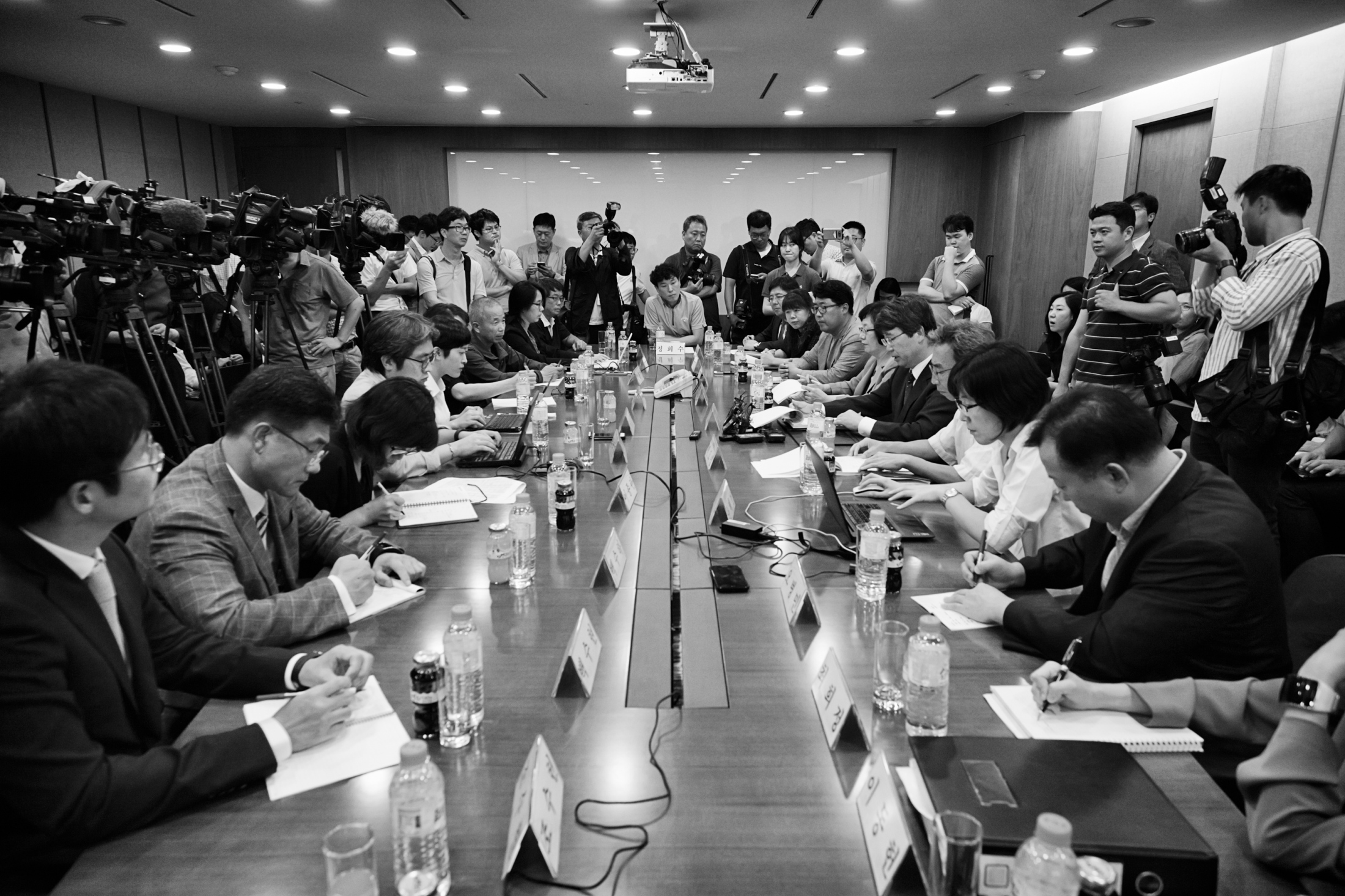 "Samsung Electronics semiconductor chip and display factories victims' families, members of ""Banolim,"" an activist group which supports and helps the victims, members of Samsung Electronics and the coordination committee members, hold the compensation council meeting for the victims at the office of a law firm ""Jipyong"" on Jul. 23, 2015 in Seoul, South Korea."