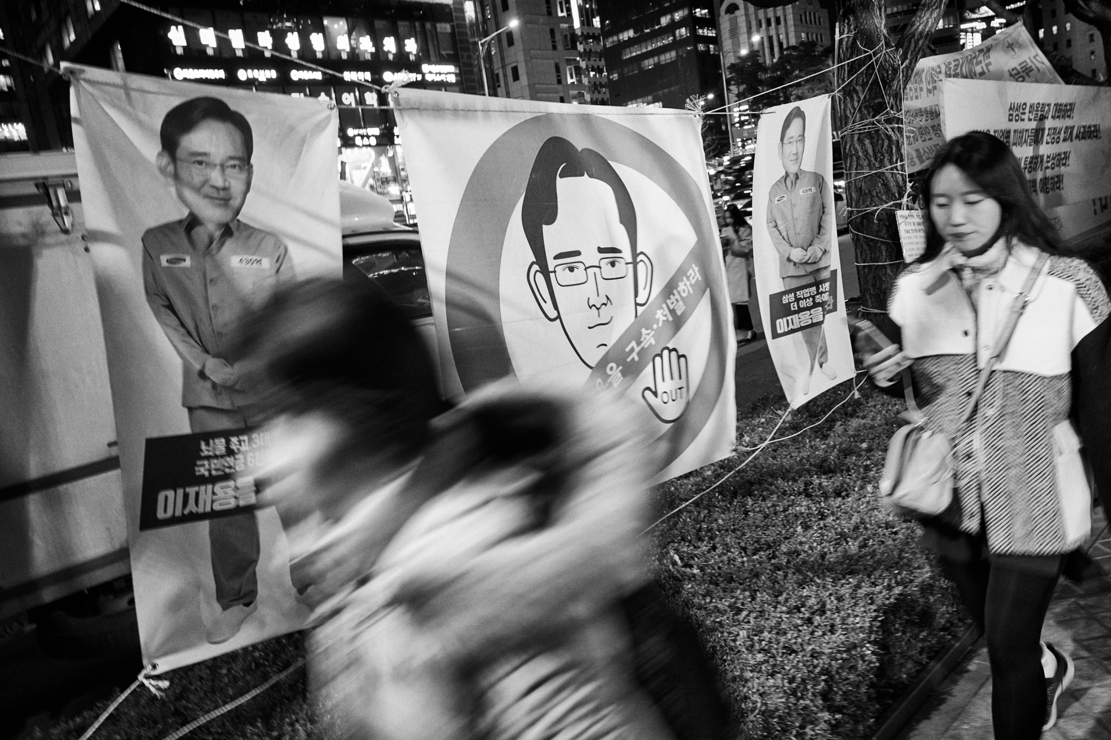 "Banners with photoshopped images of Lee Jae-yong, also known as Jay Y. Lee in the West, the vice chairman of Samsung Group and a grandson of Lee Byung-chul the founder of Samsung are seen on the street in front of Samsung Town Headquarters in Seoul, South Korea on Mar. 6, 2017. The banners were set up by the protest group who supports the victims of Samsung semiconductor chip factories and plead guilty of Mr. Lee for victims' death and also corruption. The victims' families and ""Banolim,"" an activist group which supports and helps the victims hold the memorial ritual for the victims on every March 6th since 2008. The victims who worked in Samsung Electronics semiconductor chip and display factories died of critical disease like leukemia, cancer and brain tumor due to toxic chemicals they had handled during manufacturing processes. According to Banolim, 112 former semiconductor chip and display factory workers have died among 306 reported cases. Lee was arrested on Feb. 17, 2017 for his alleged role in the corruption scandal which led to the impeachment of President Park Guen-hye. Lee was accused of bribery, embezzlement and hiding assets overseas and perjury by the special prosecutors' team which investigate the worst corruption scandal in South Korean history."