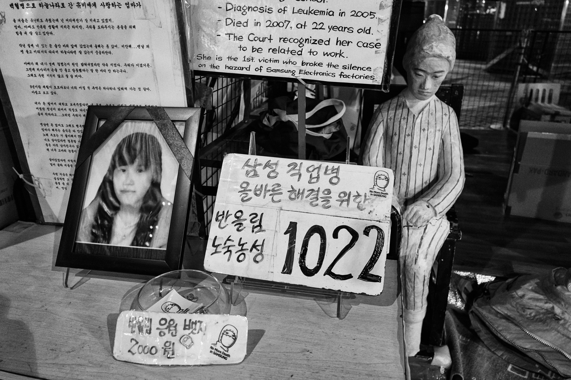 A portrait and a statue of the late Hwang Yu-mi is seen at a protest camp in front of Samsung Town Headquarters in Seoul, South Korea on Jul. 24, 2018.