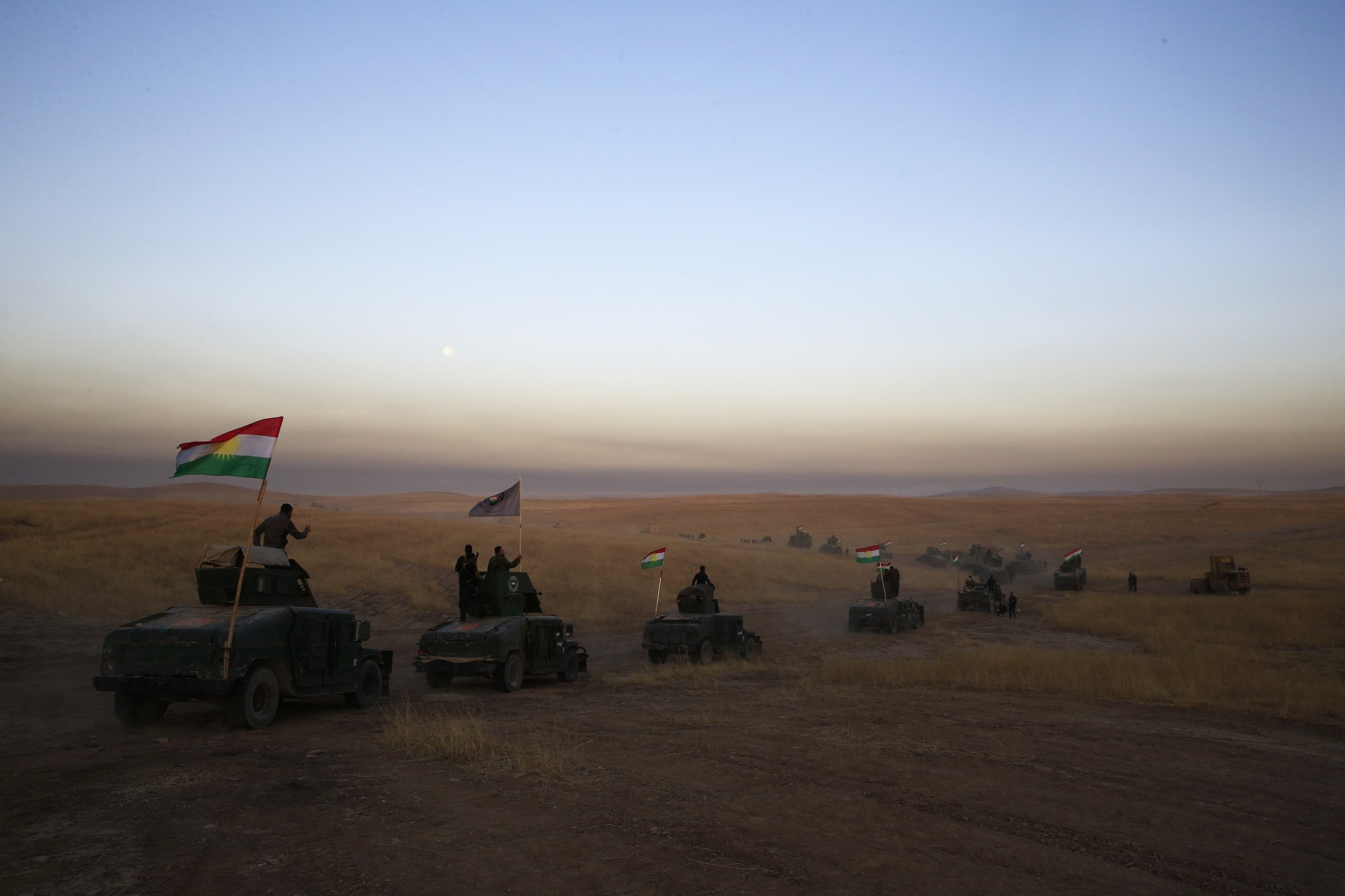 A Kurdish Peshmerga convoy drives towards a frontline on Monday, Oct. 17, 2016. The Iraqi military and the country's Kurdish forces say they launched operations to the south and east of militant-held Mosul early Monday morning.